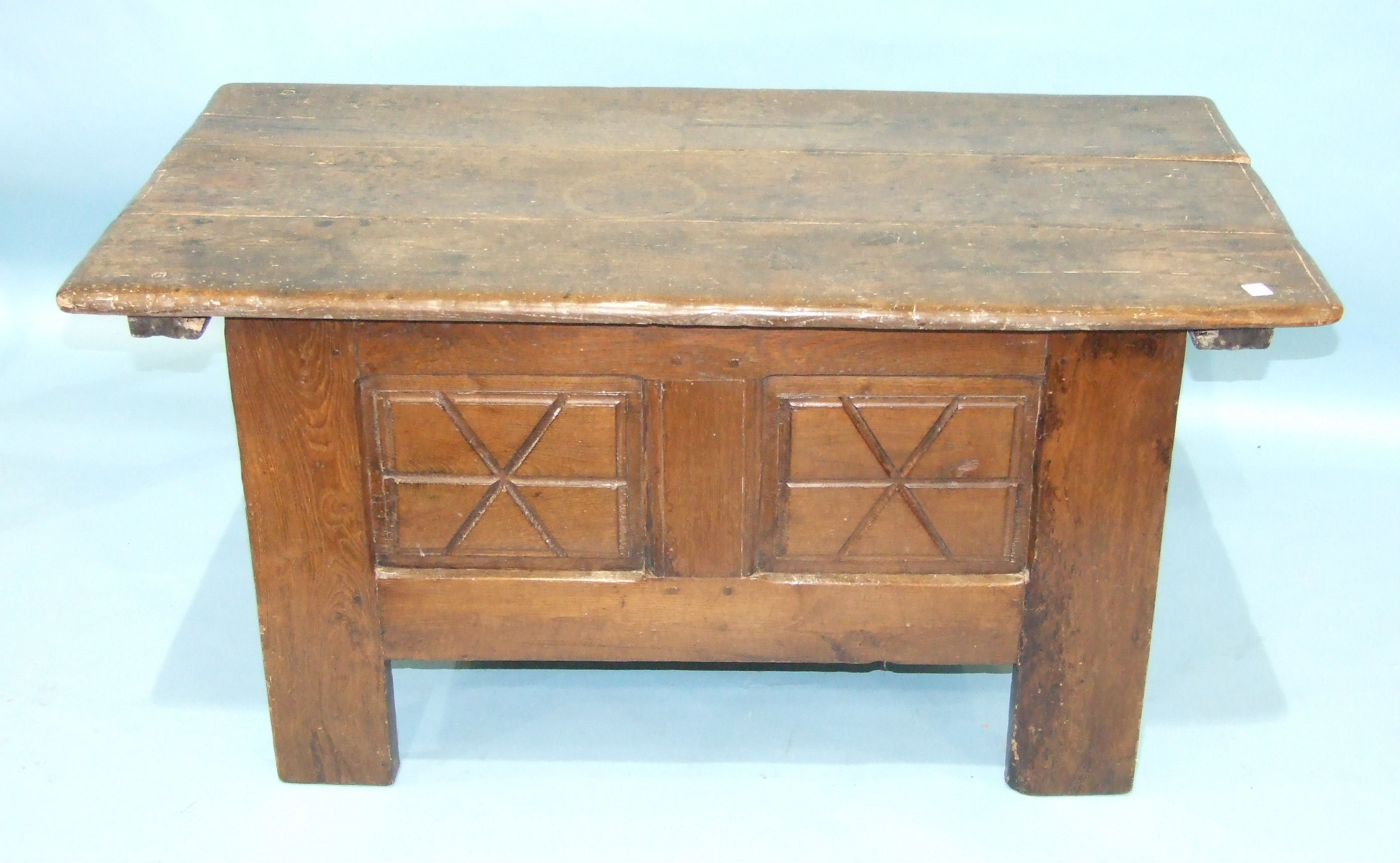 Lot 99 - An unusual Continental hardwood coffer, the rectangular base with panelling to each side