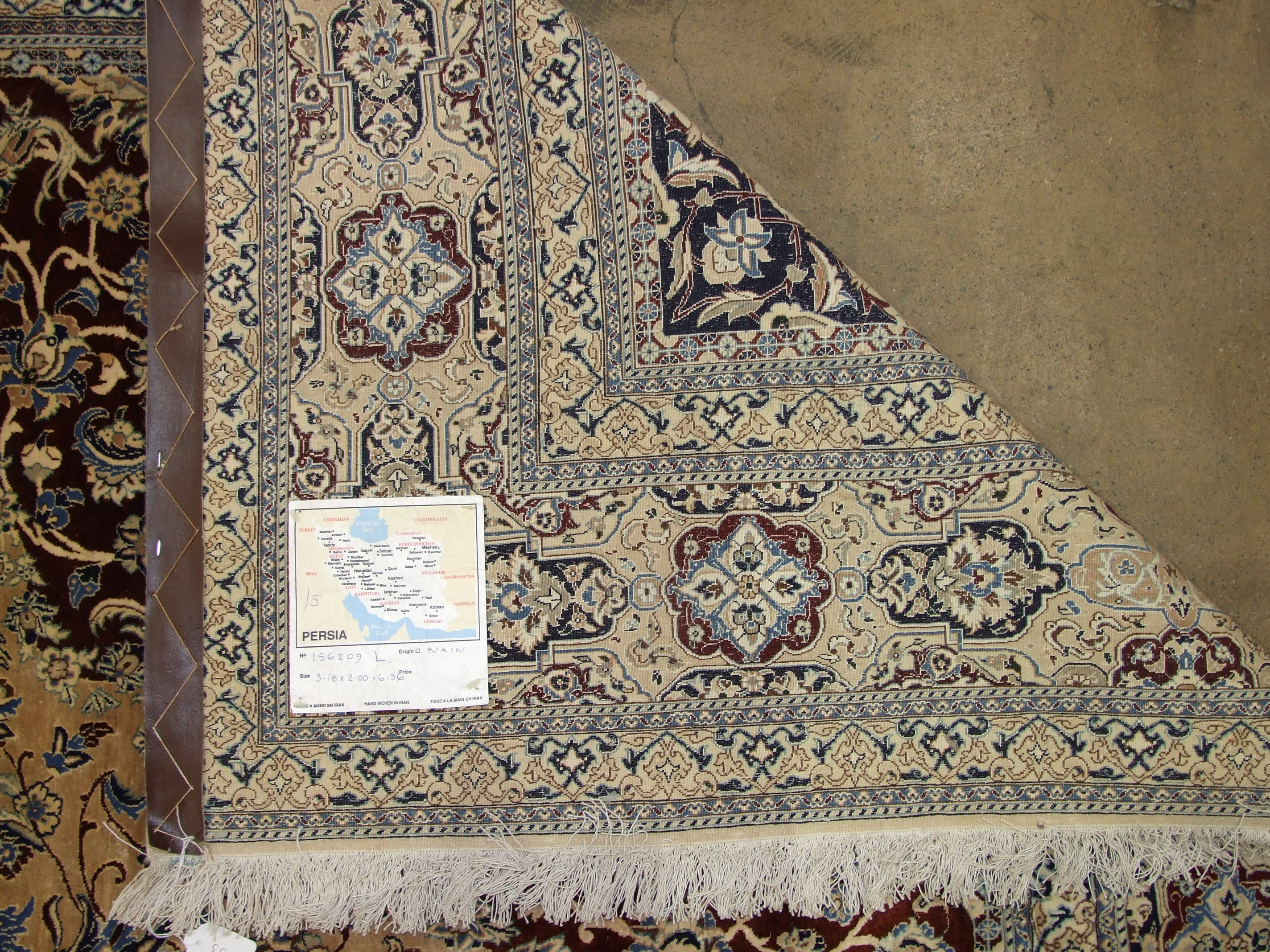 Lot 133 - A Nain Persian carpet decorated overall with foliate pattern, the central lozenge with stylised