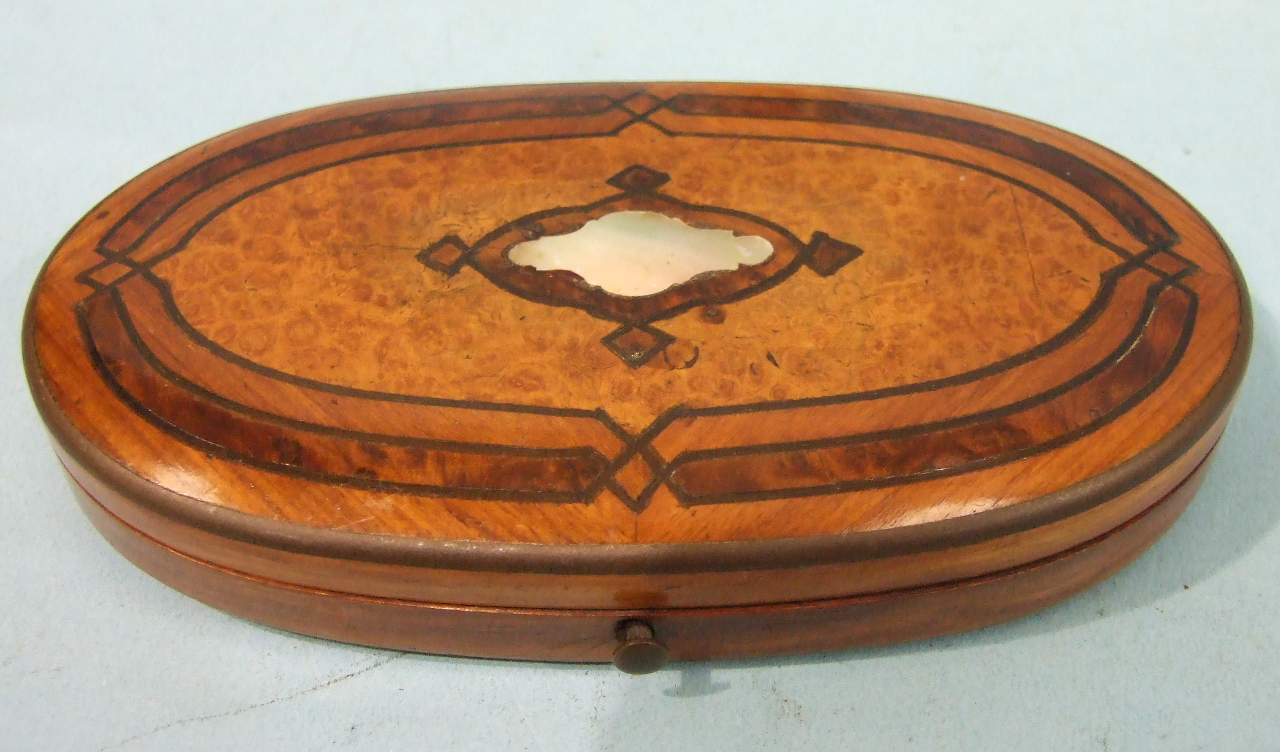 Lot 146 - A 19th century Continental etui, the oval burr wood and mother-of-pearl-inlaid case containing