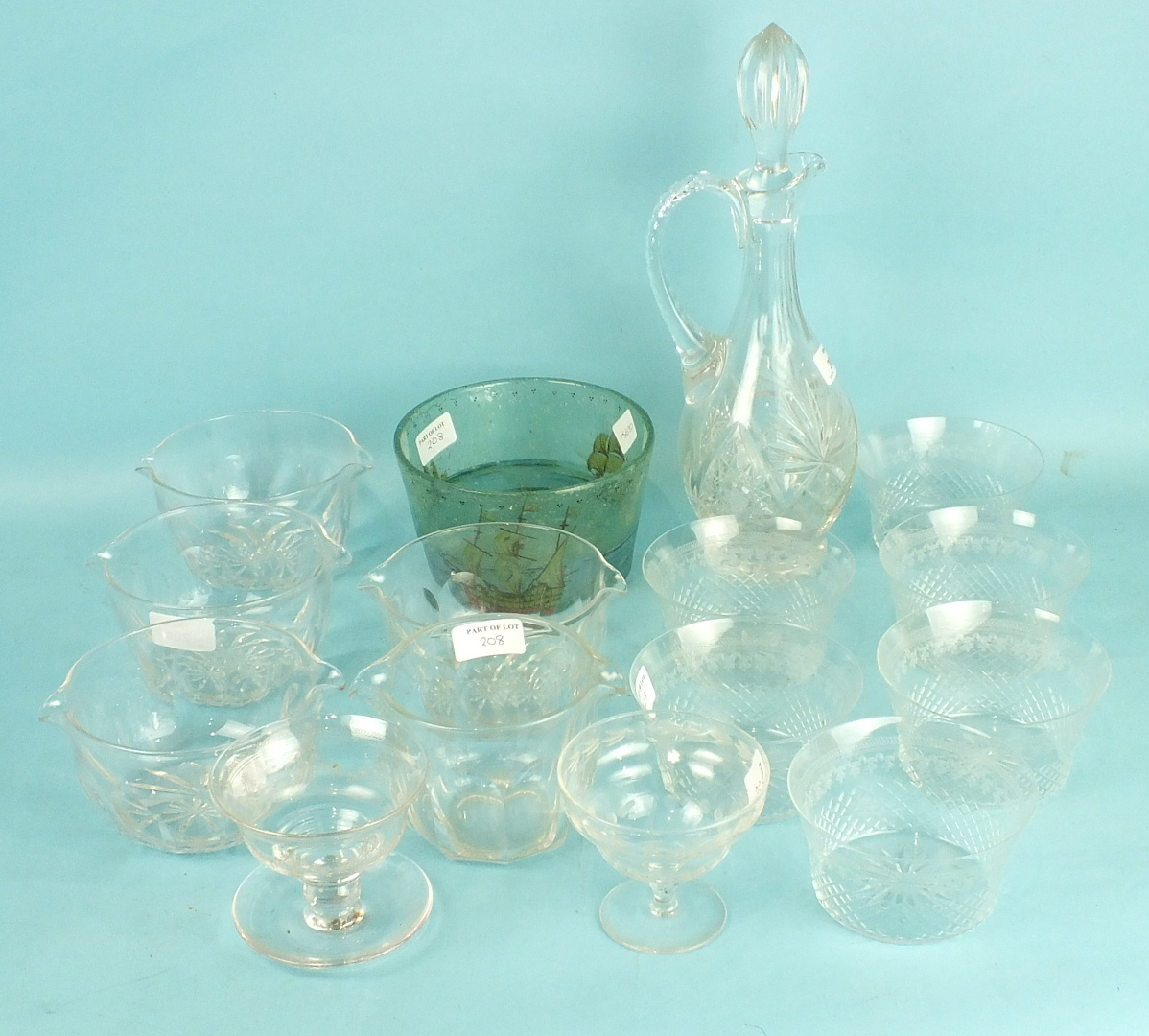 Lot 208 - Four cut-glass finger bowls, 16cm diameter, a cut-glass wine jug and stopper and other glassware.