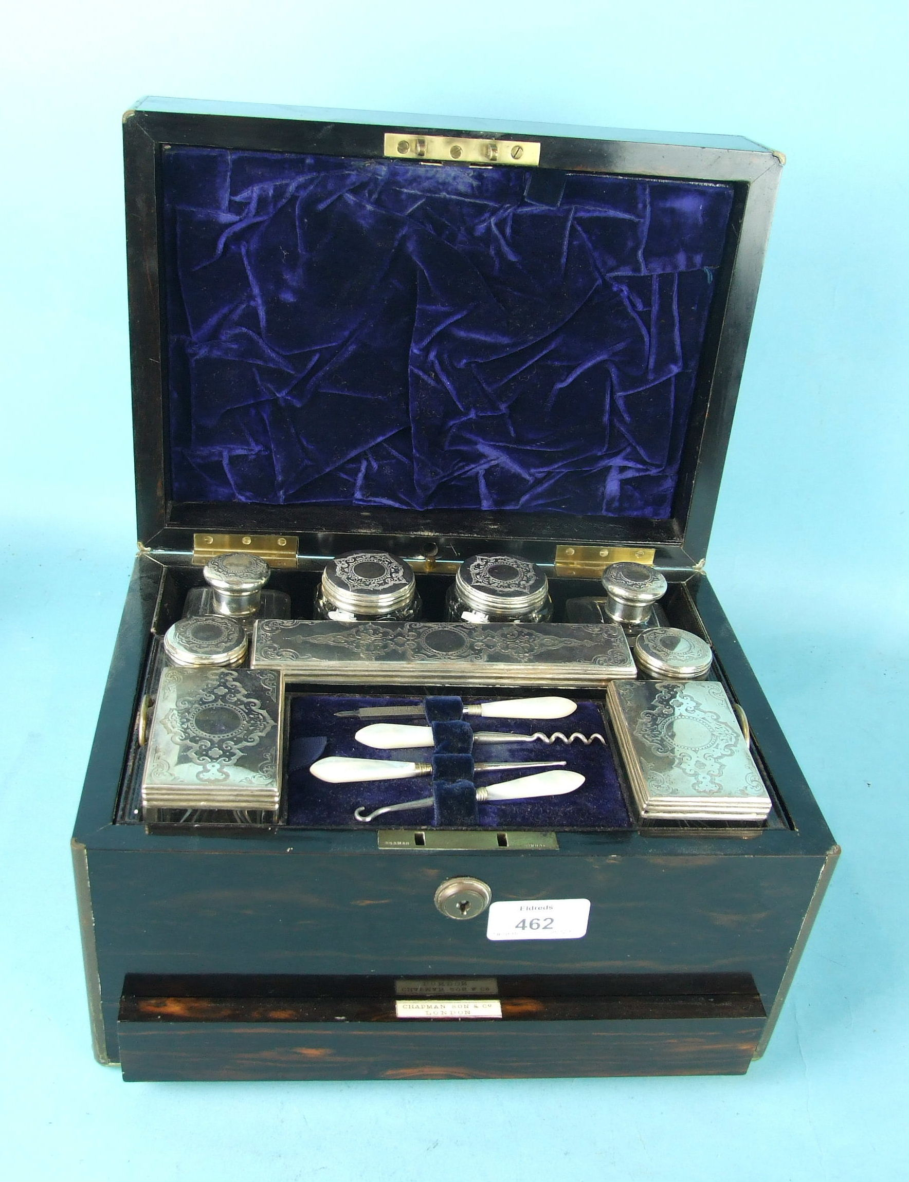 Lot 463 - A Victorian ladies coromandel wood brass-bound dressing case by Chapman Son & Co, London, fitted