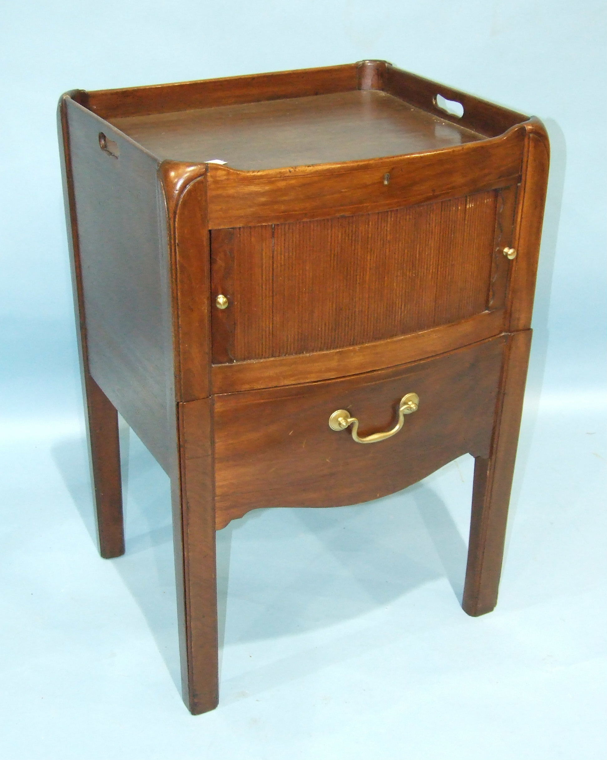 Lot 71 - A Georgian mahogany tray-top commode of slightly-bowed shape, with tambour cupboard, on square