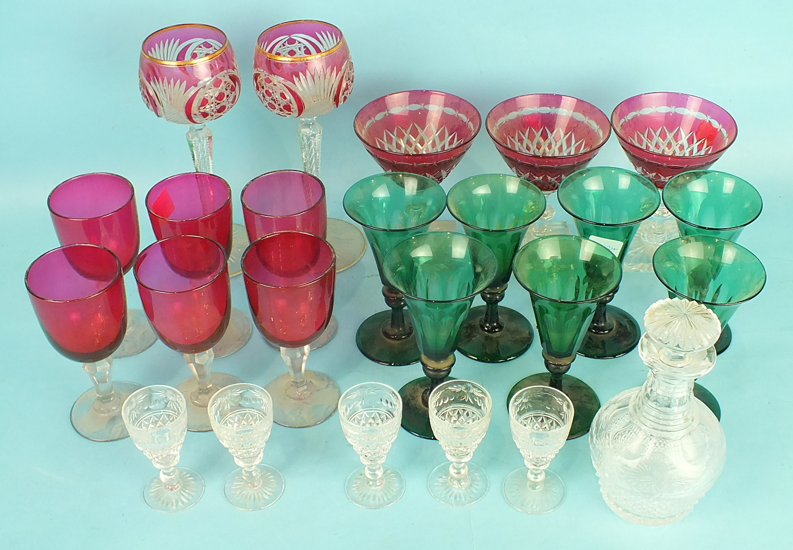 Lot 206 - A set of six green glass wine glasses, the faceted bowls on knopped stems and plain circular feet,