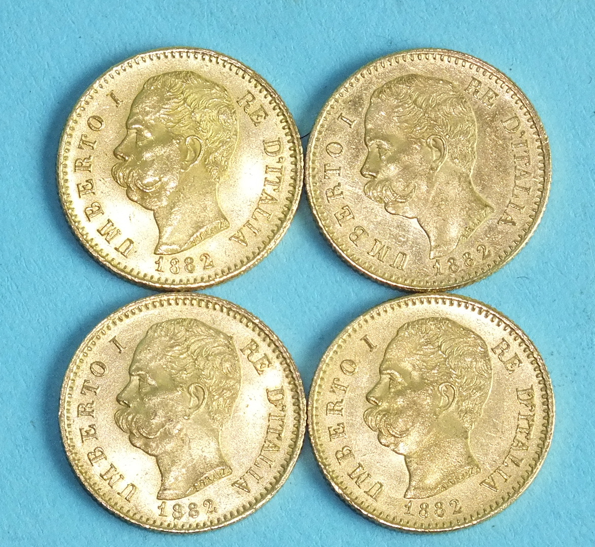 Lot 388 - Four Italian Kingdom Umberto I 20-Lire coins, 1882, (4).