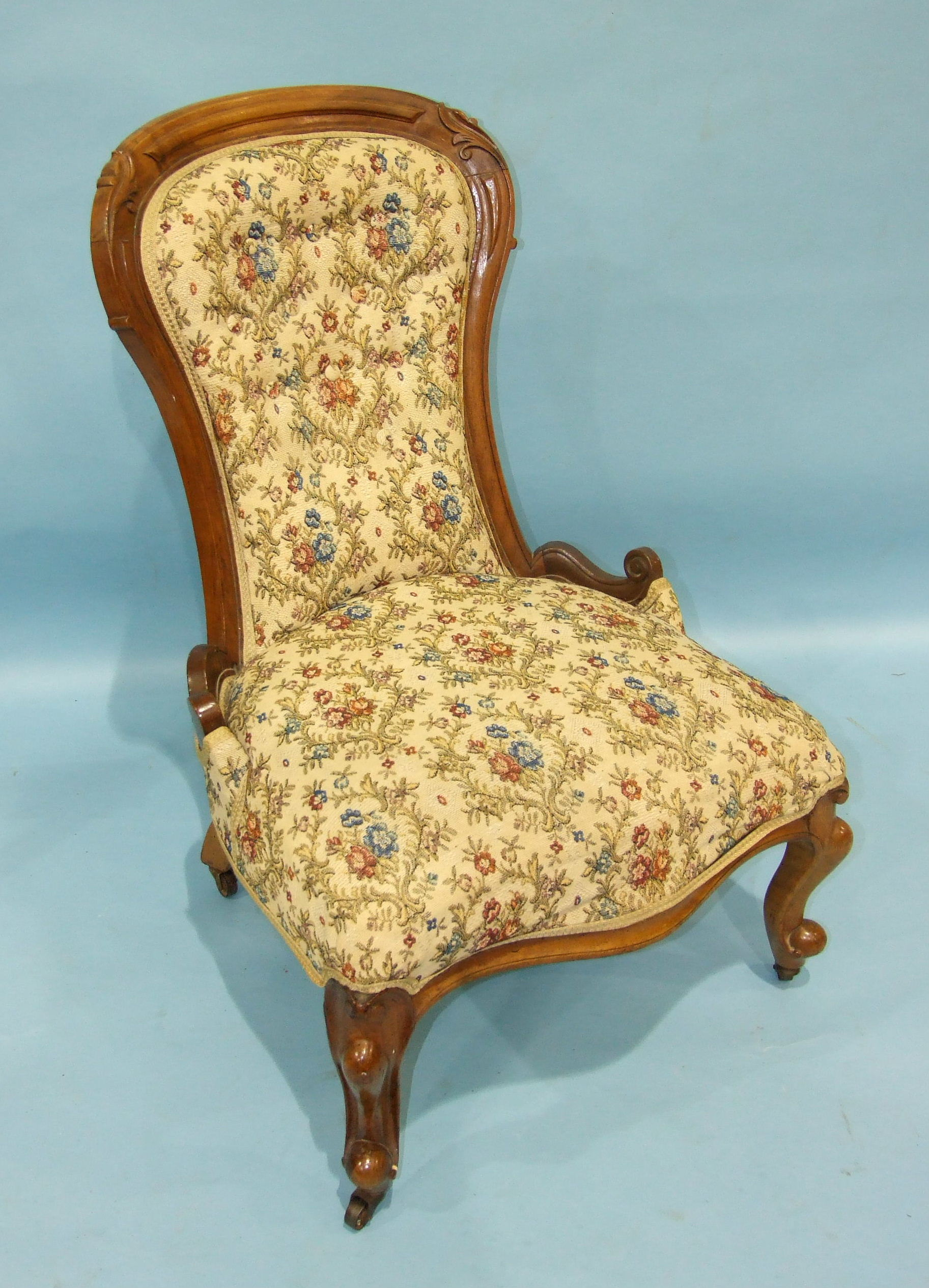 Lot 73 - A late-Victorian walnut nursing chair on carved cabriole legs, similar to lot 72.