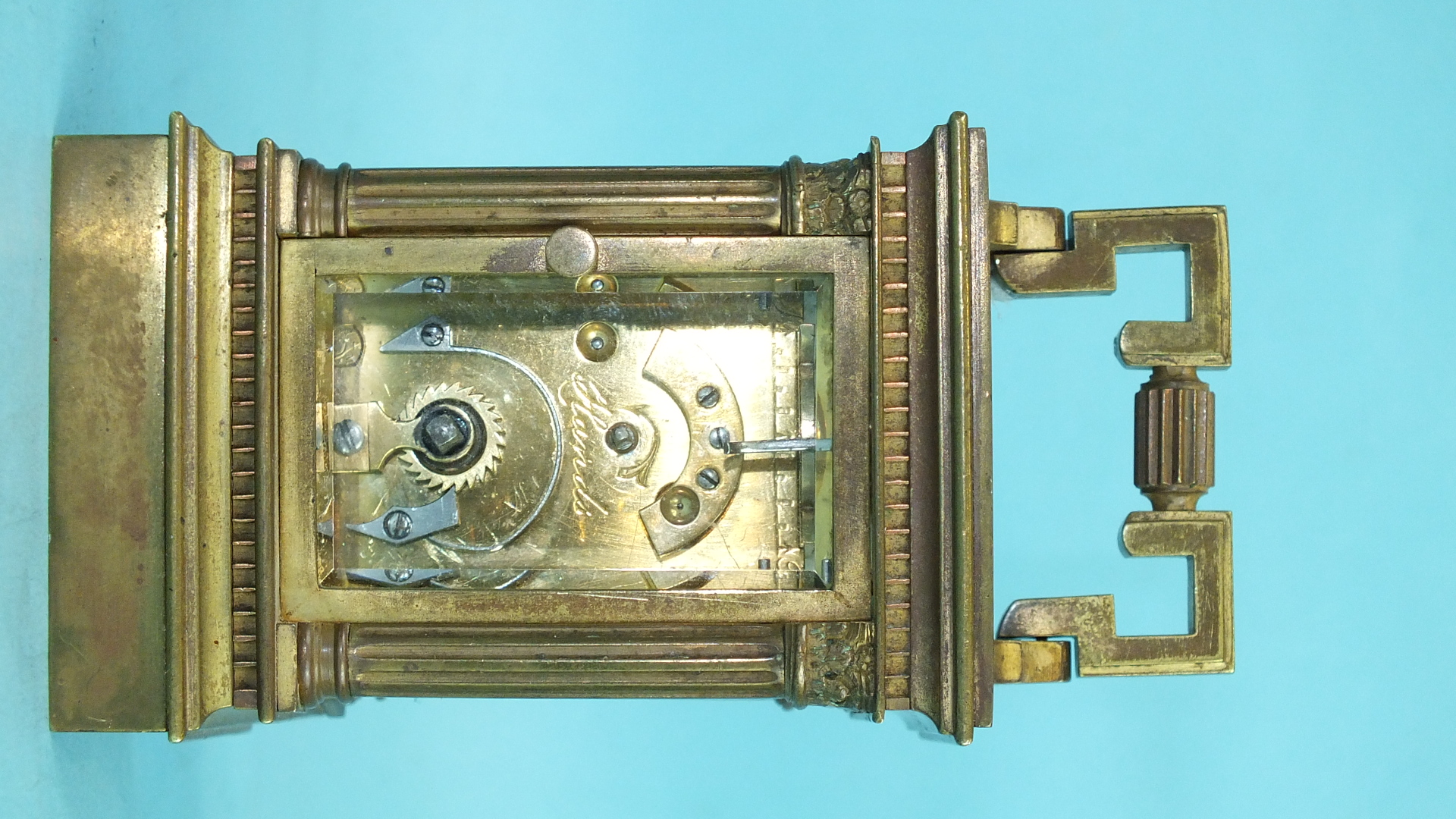 Lot 118 - A miniature brass carriage clock, the pillar and corniced case with rectangular enamelled dial, 11cm