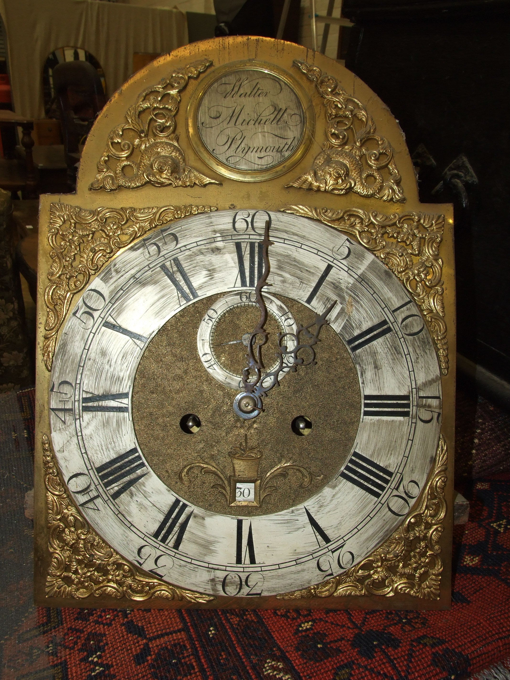 Lot 121 - Walter Michell, Plymouth, a mid-18th century long case clock, the green lacquered case decorated