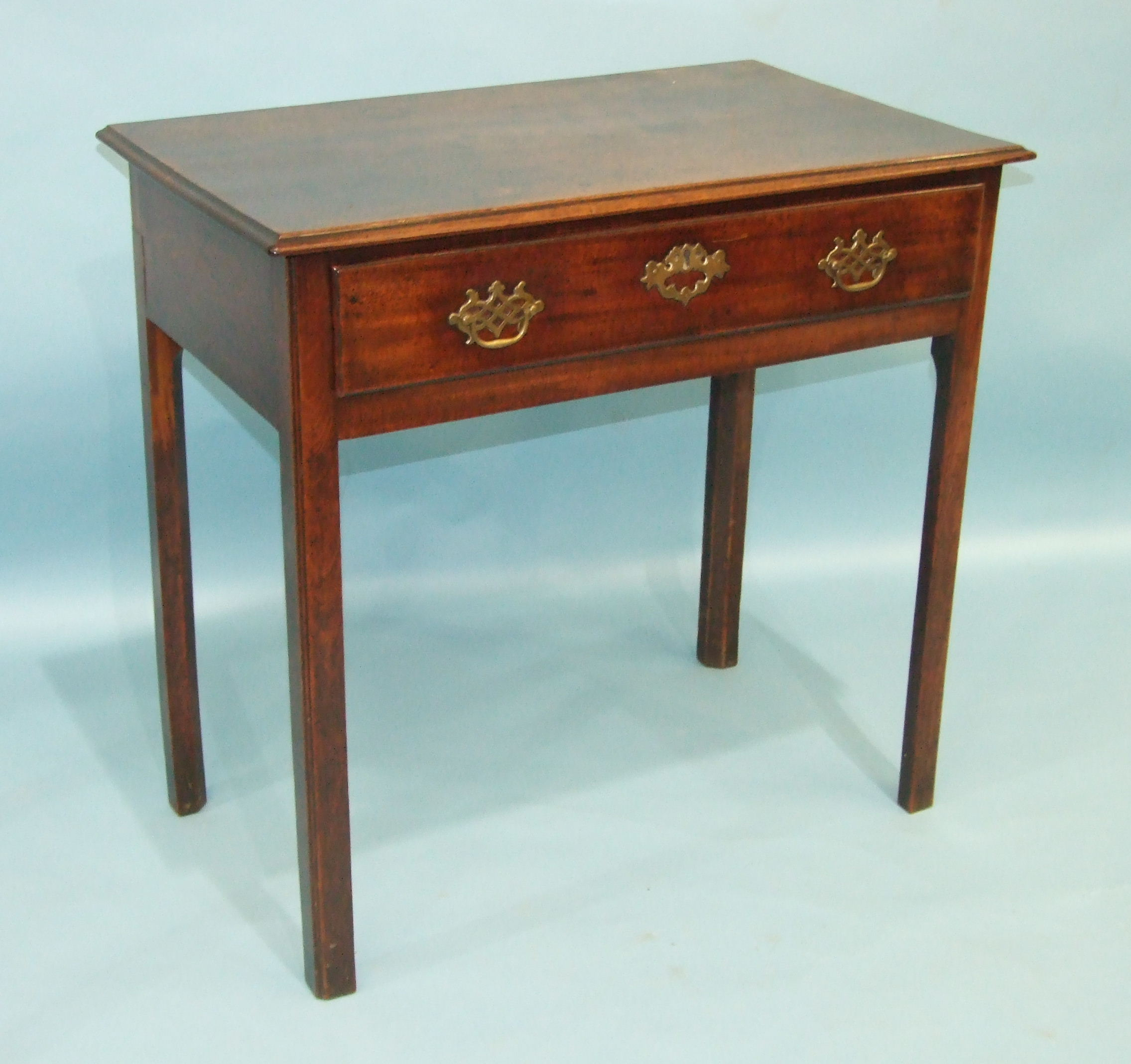 Lot 75 - A George III mahogany side table, the rectangular top with moulded edge above a single drawer, on