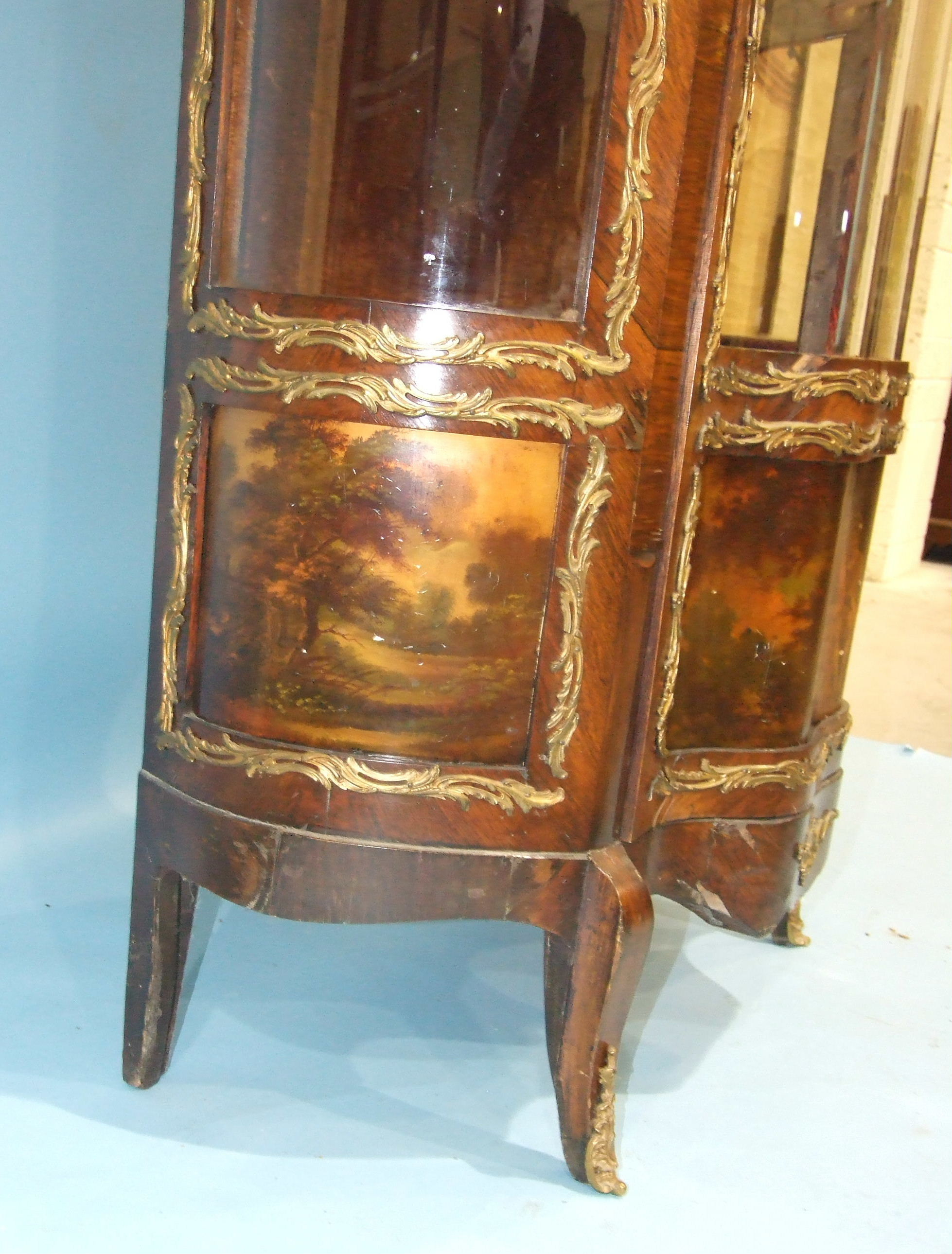 Lot 112 - A 19th century rosewood Vernis Martin display cabinet with bowed, glazed sides and triple concave