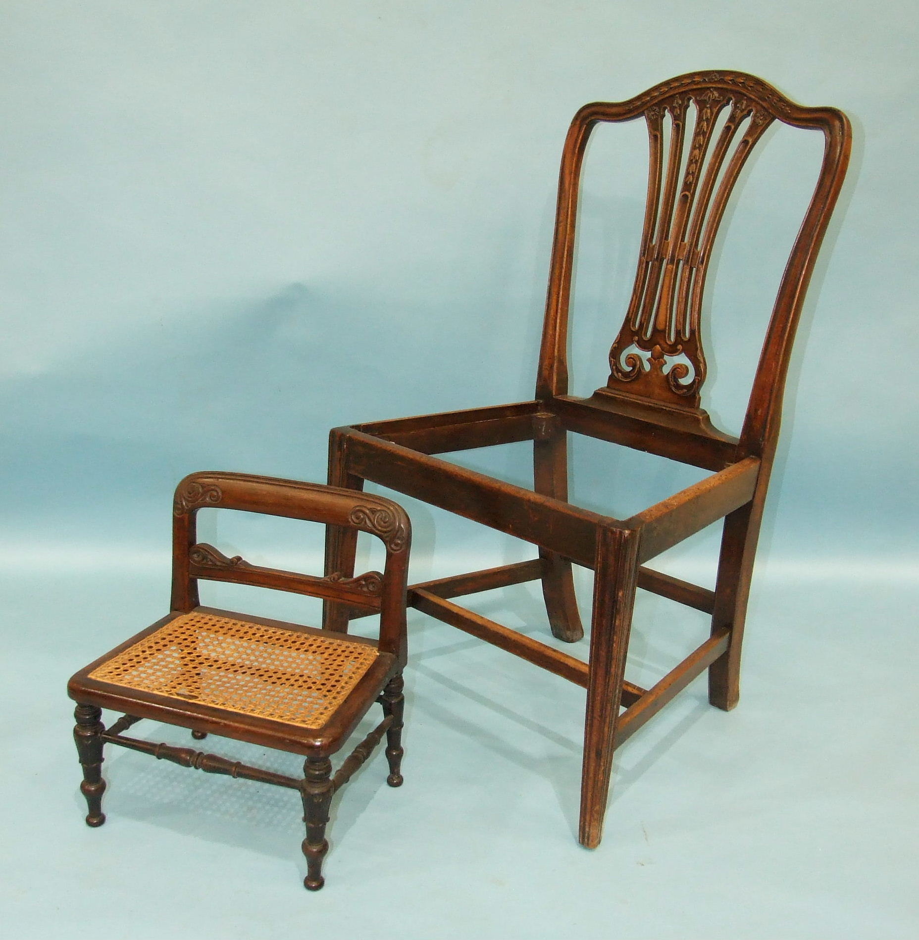 Lot 78 - A 19th century rosewood child's chair with cane seat and carved turned legs, 33cm wide, 41cm high.