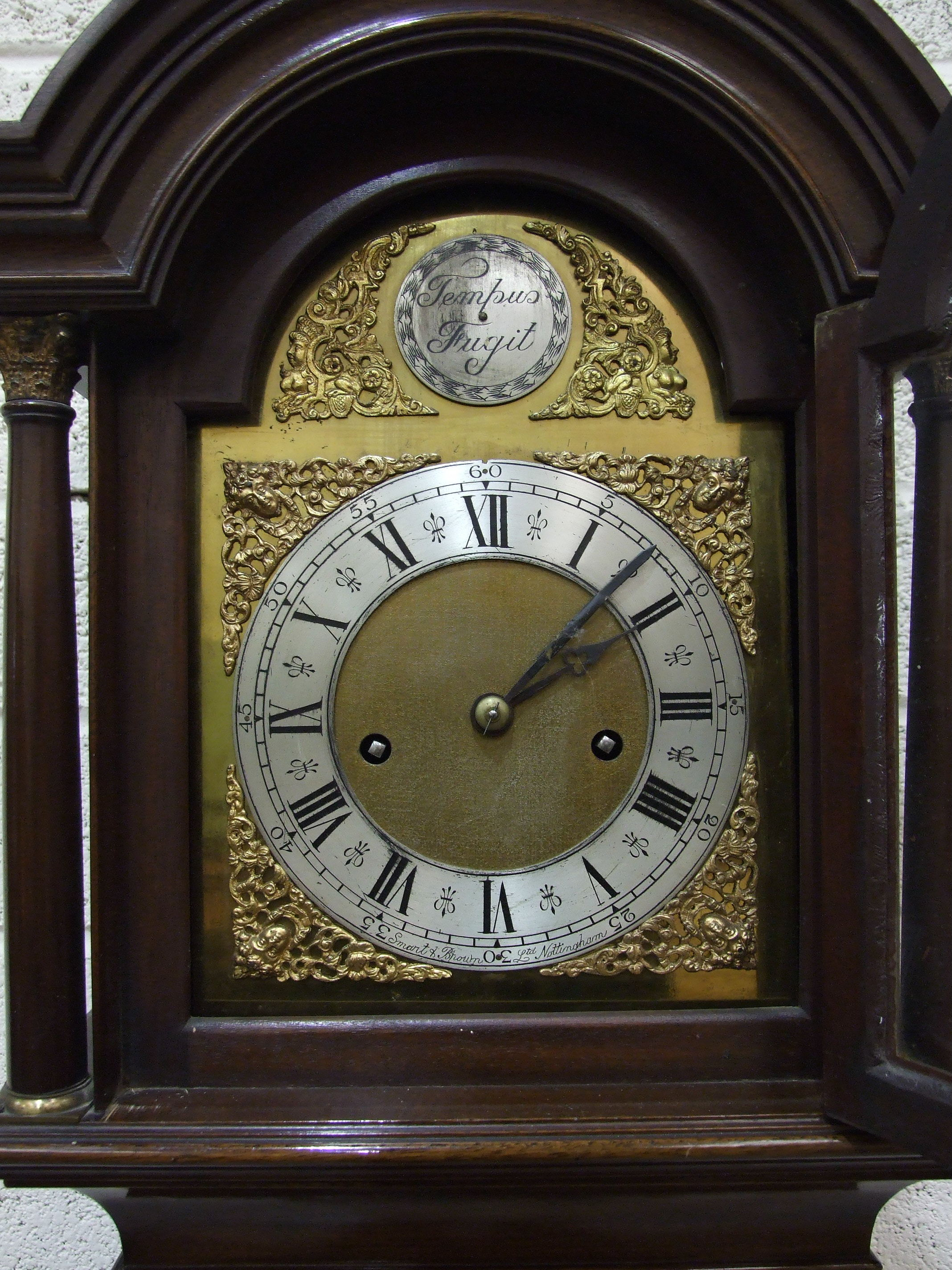 Lot 129 - Smart and Brown Ltd, a 20th century mahogany grandmother clock, the arch brass dial, silver