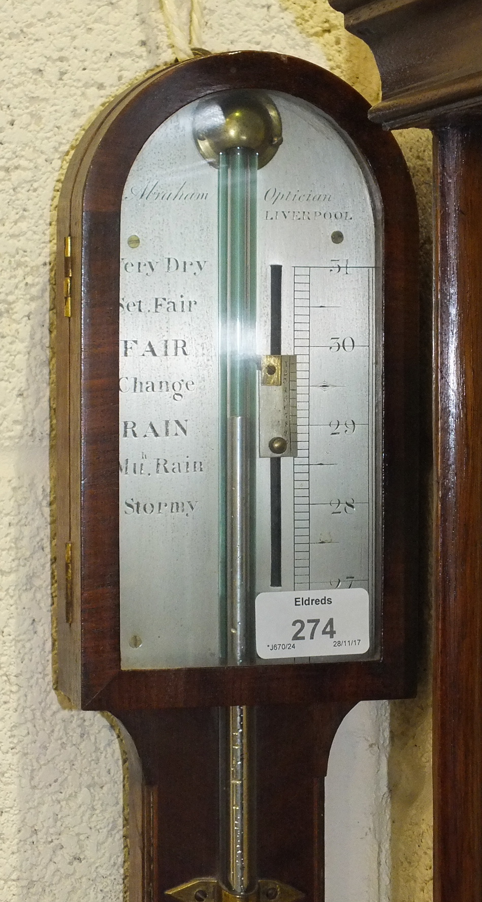 Lot 117 - A late-Georgian mahogany stick barometer, the plain arch case with ball cistern cover and hinged