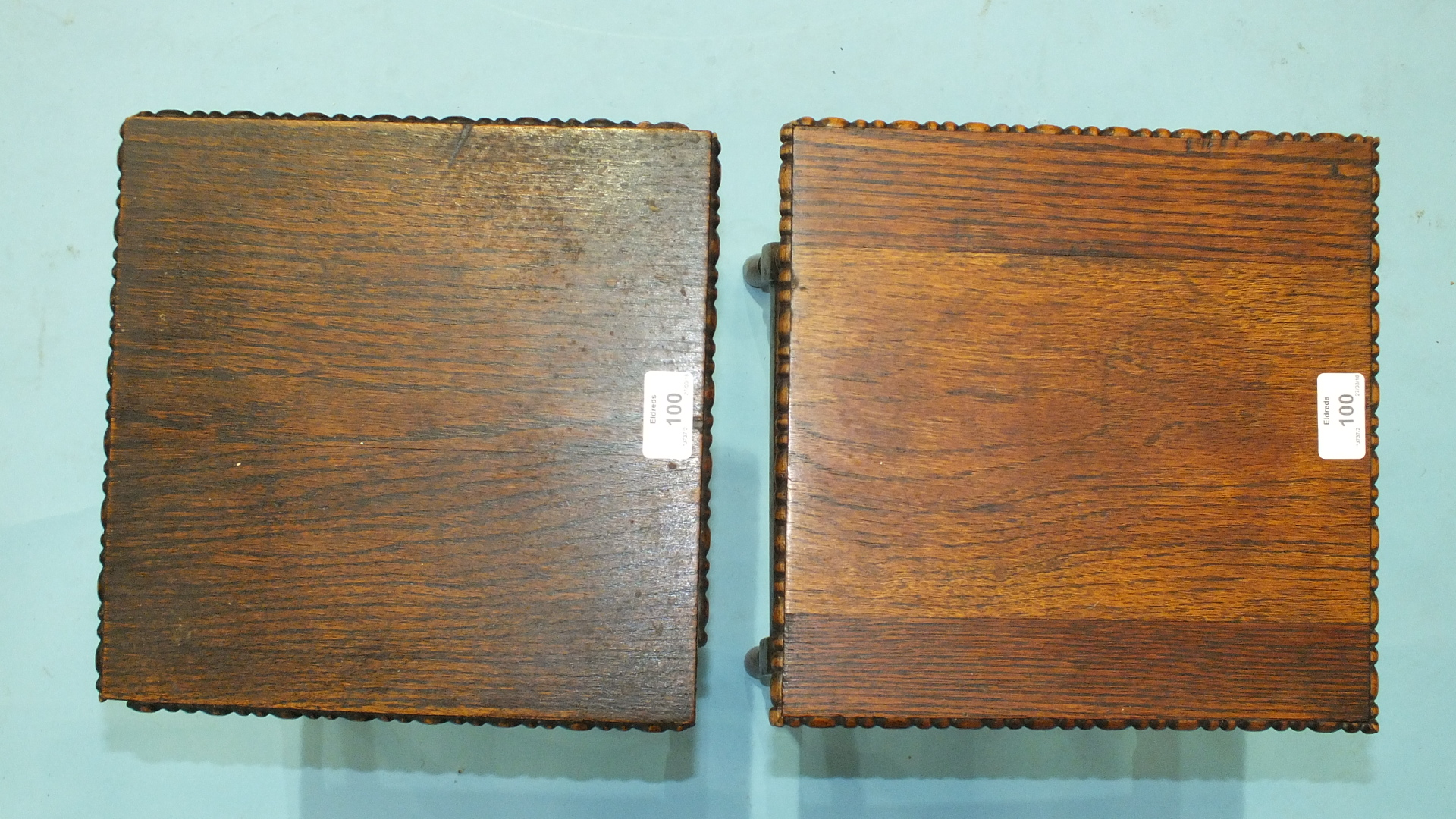 Lot 100 - A pair of 1930's oak plant stands, each with rectangular top raised on bobbin-turned legs joined