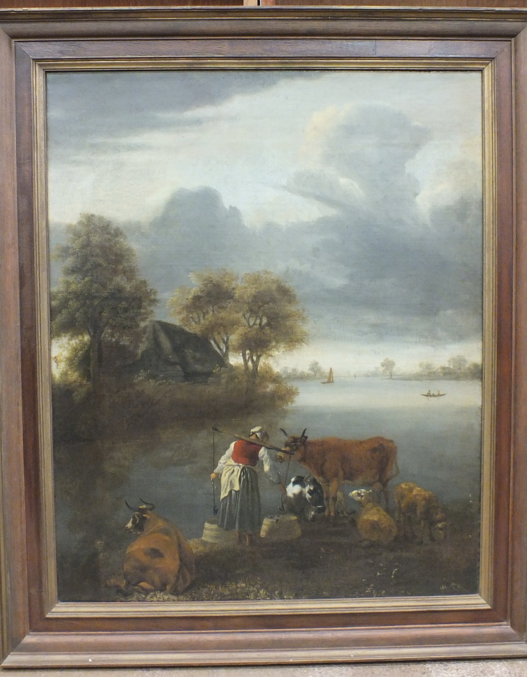 Lot 3 - 19th century Continental School A MILKMAID, CATTLE AND SHEEP BY A LAKE Unsigned oil on canvas, 80