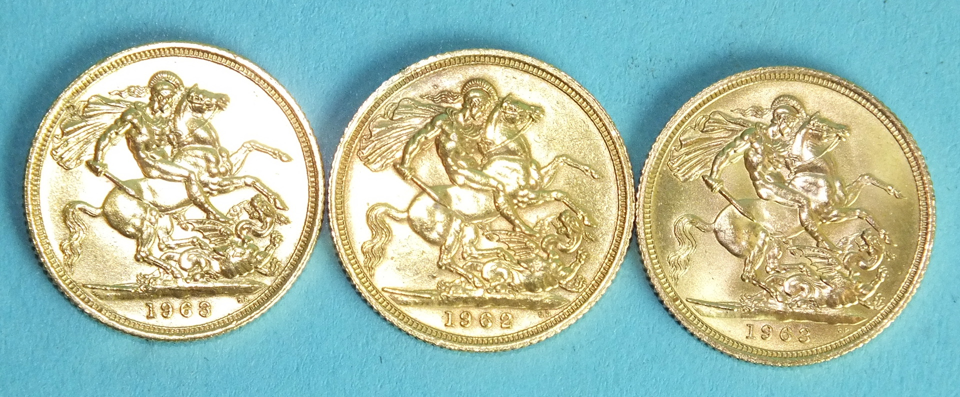 Lot 377 - An Elizabeth II 1962 sovereign and two 1963 sovereigns, (3).