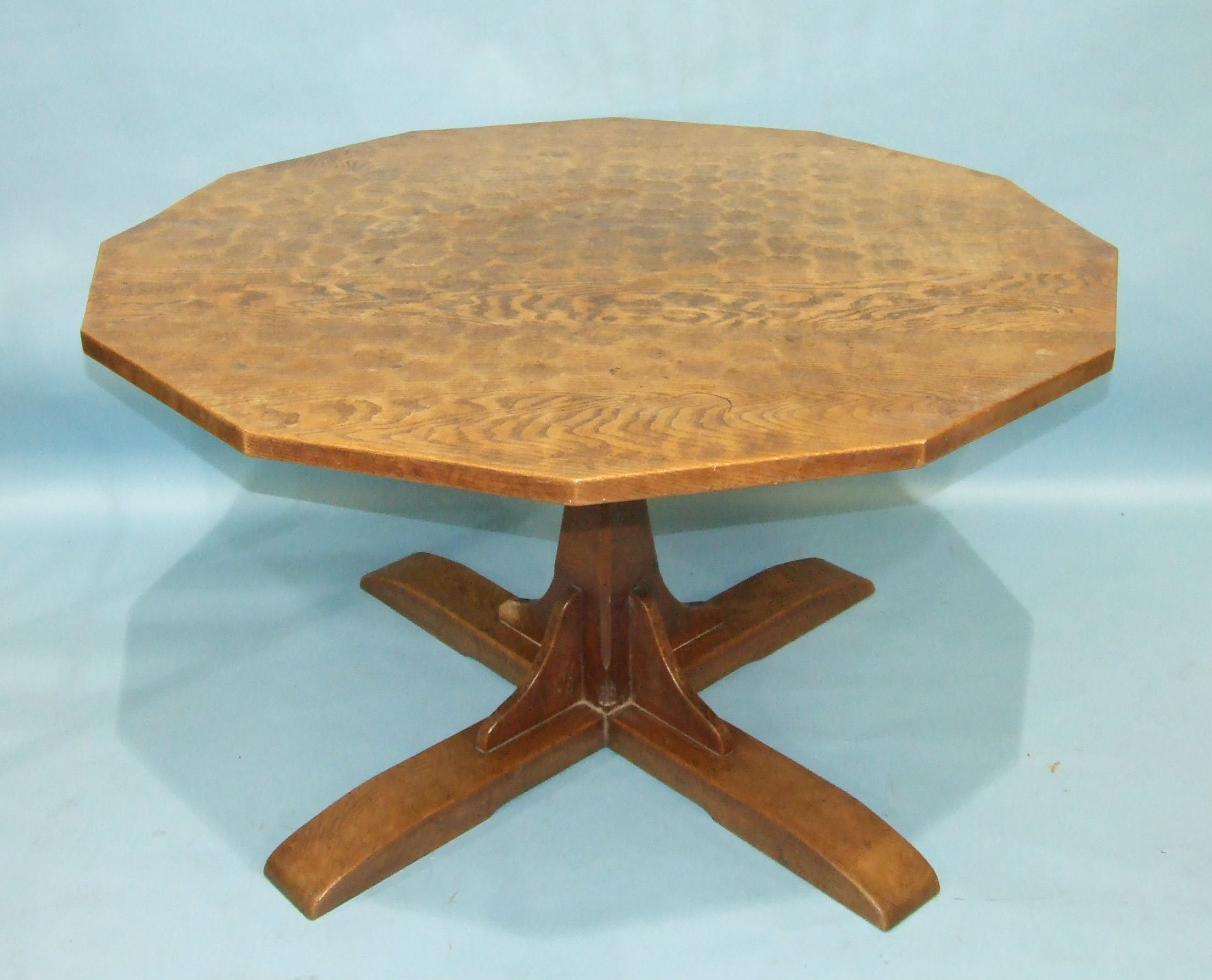 Lot 108 - A Thomas 'Gnomeman' Whittaker oak twelve-sided dining table, the adzed top on a central pillar