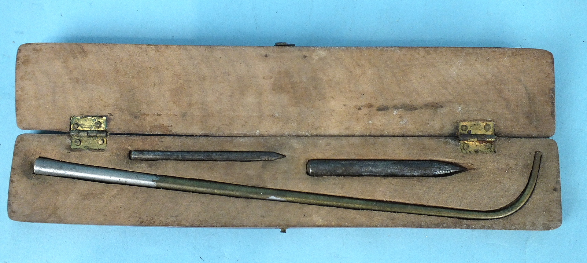 Lot 181 - An early 20th century egg blowing set comprising two awls and a curved metal tube, in fitted