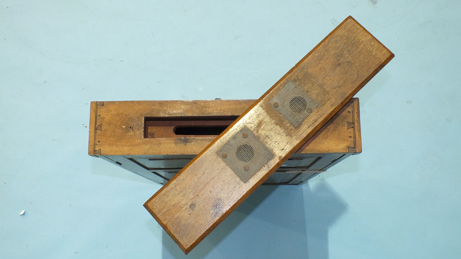 Lot 110 - A teak observation hive display case, the glass-fronted double-sided 'hive' with removable glass