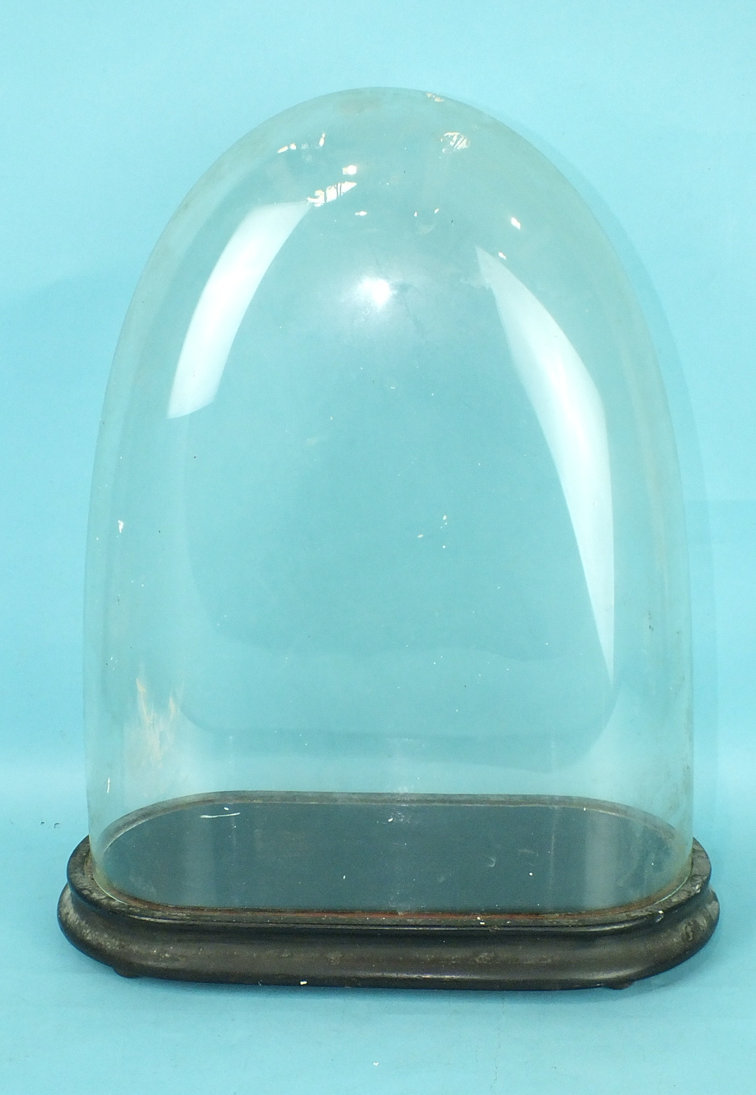 Lot 169 - A glass dome on stand, 40cm high, 38cm inside.