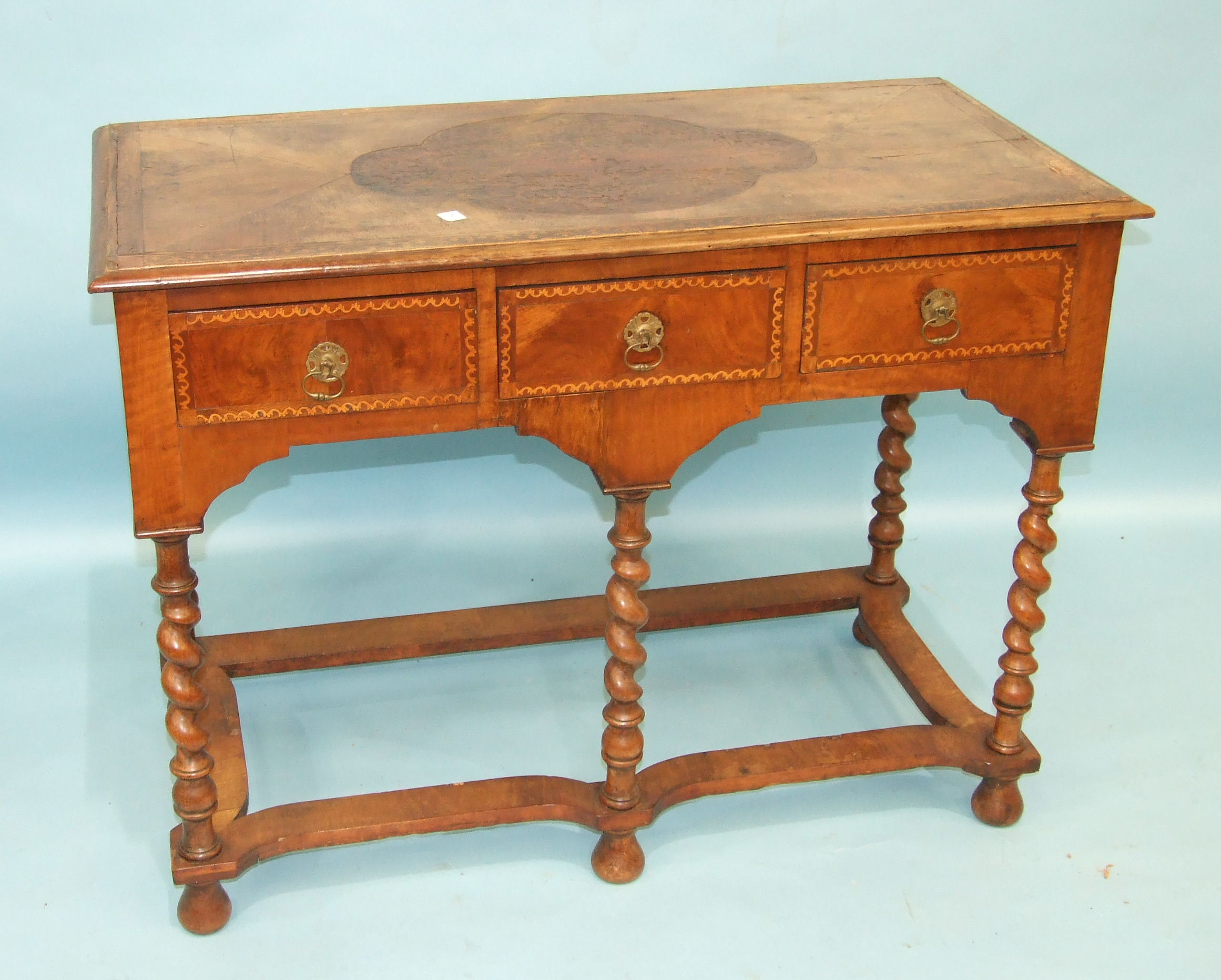 Lot 101 - An 18th century inlaid walnut side table, the top and three frieze drawers on spiral-twist legs