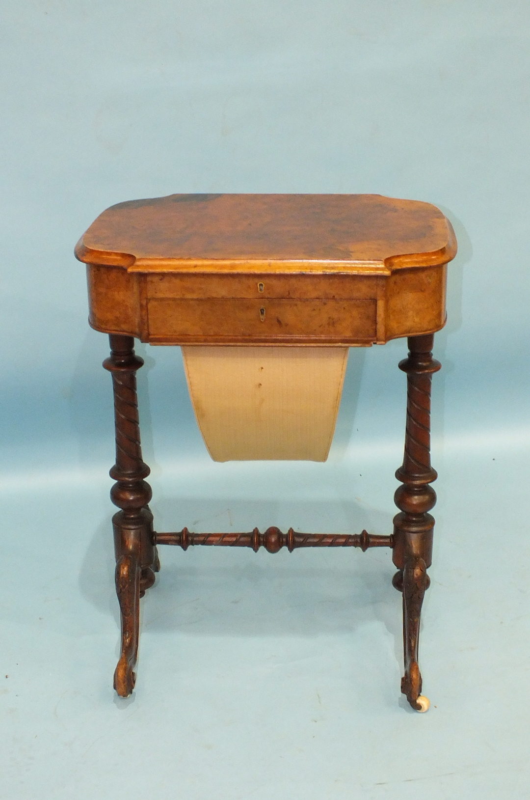 Lot 63 - A Victorian walnut workbox and writing desk, the lift lid revealing a writing surface above a fitted