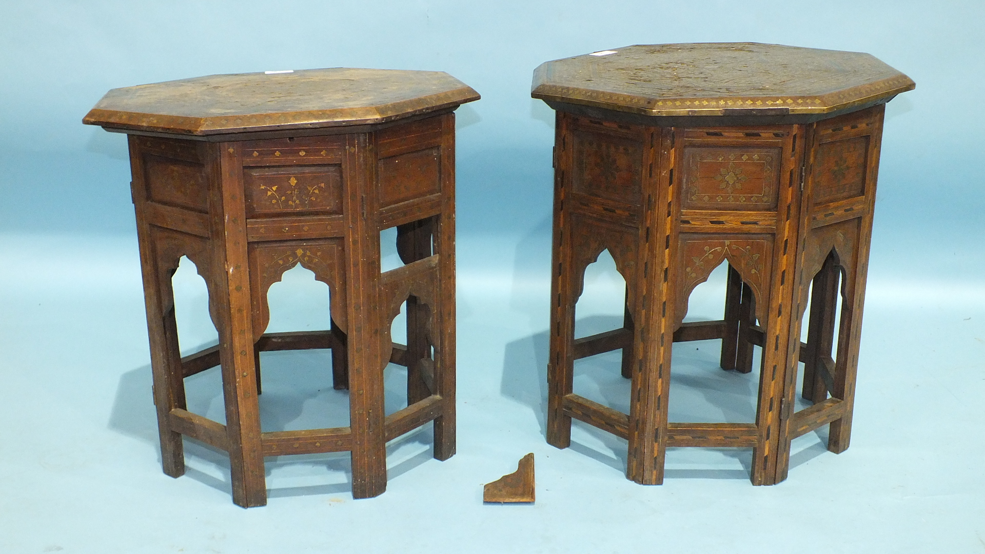 Lot 69 - Two octagonal brass inlay hardwood occasional tables with hinged folding stands, (some inlay
