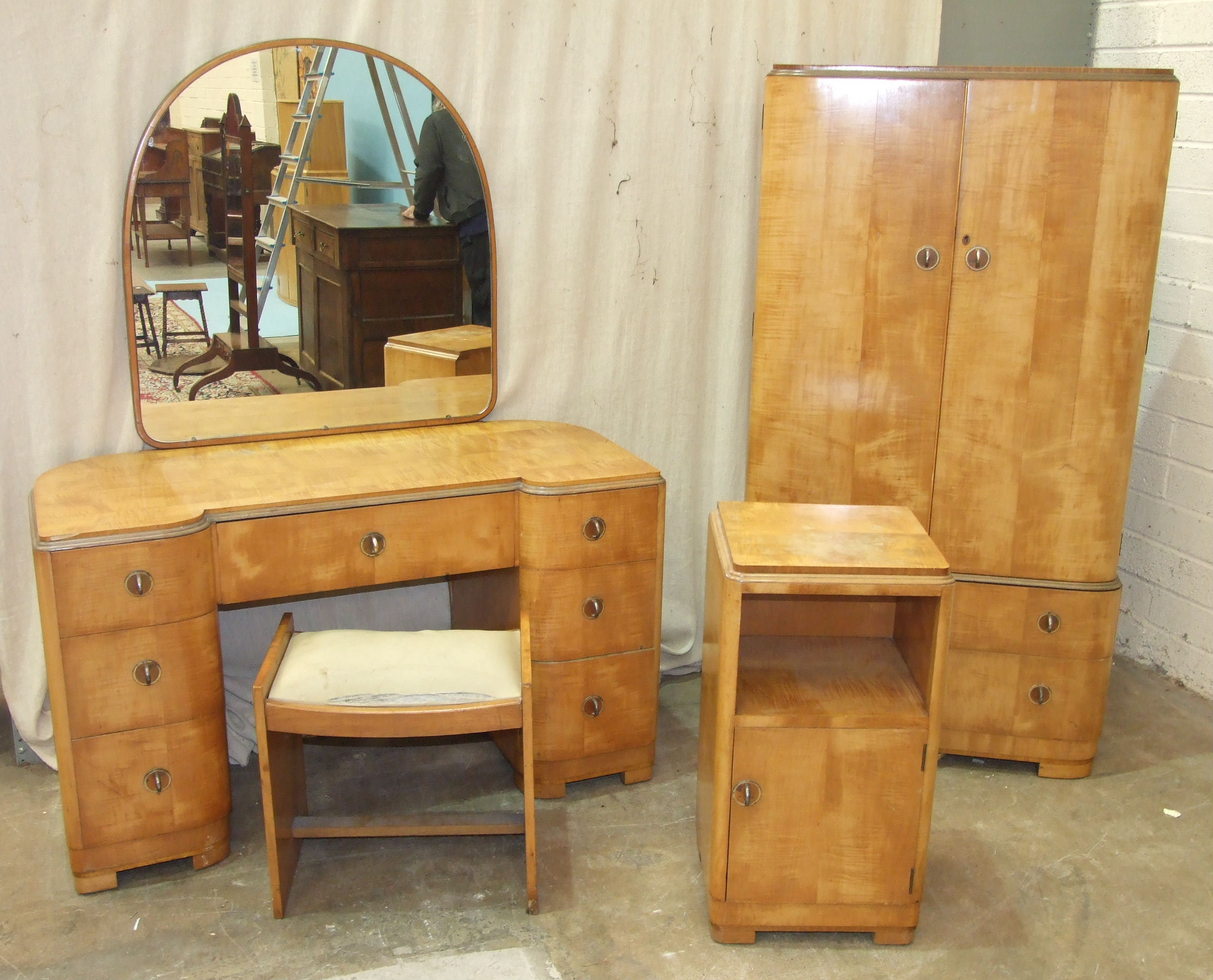 Lot 66 - A satinwood gentleman's wardrobe, matching dressing chest, stool and bedside cupboard in the Art