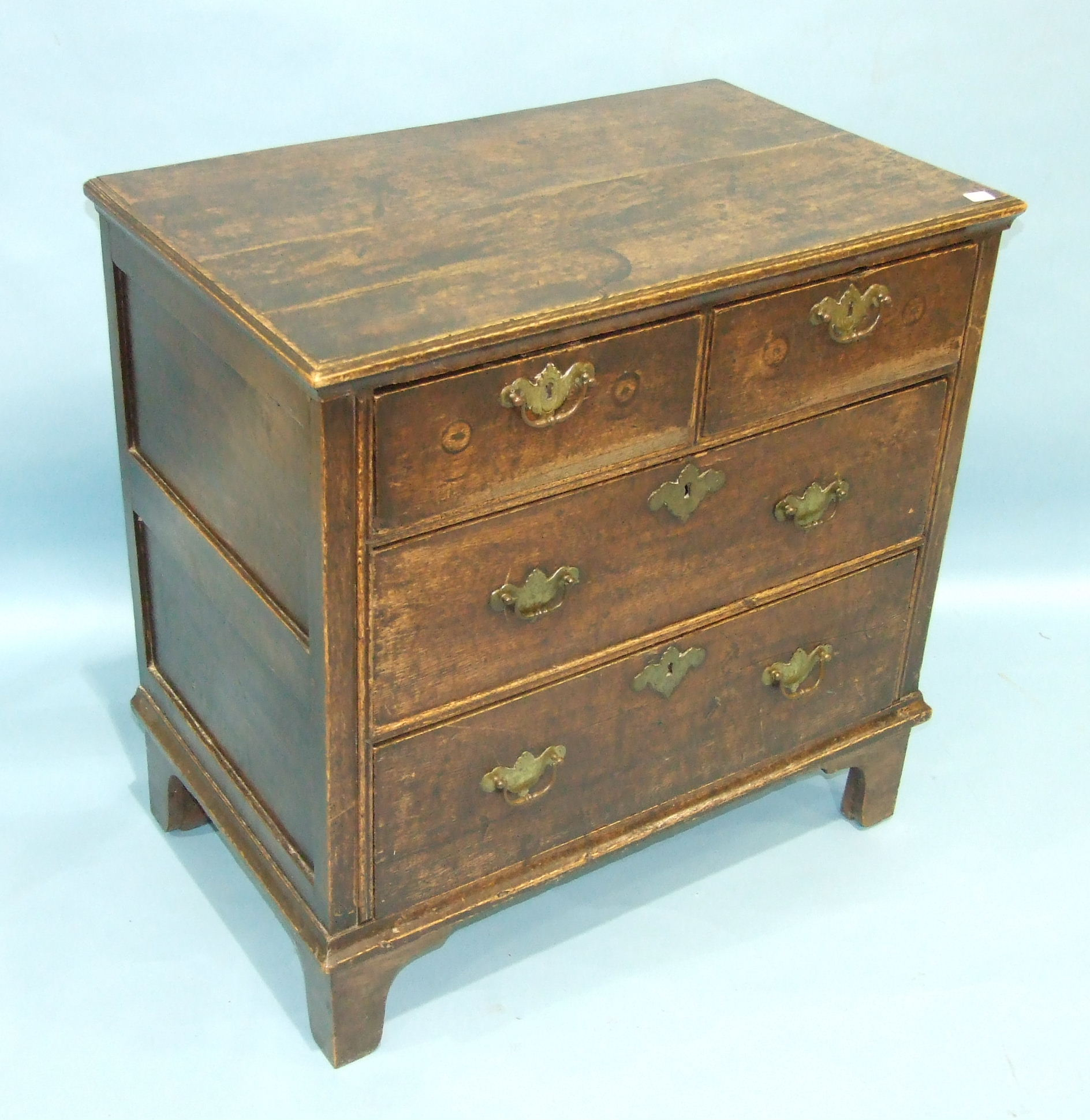 Lot 80 - A reconstructed antique oak chest of rectangular form, having two short and two long drawers, on