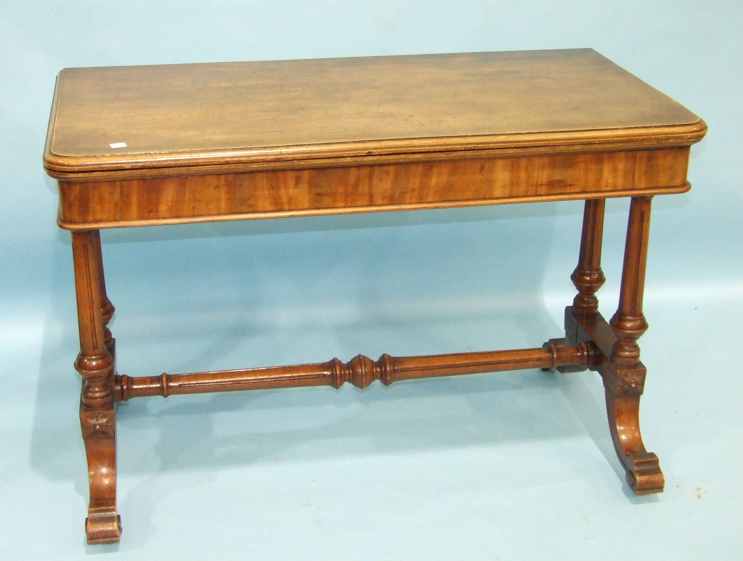 Lot 92 - A late-19th century large mahogany card table, the fold-over top with moulded edge swivelling to