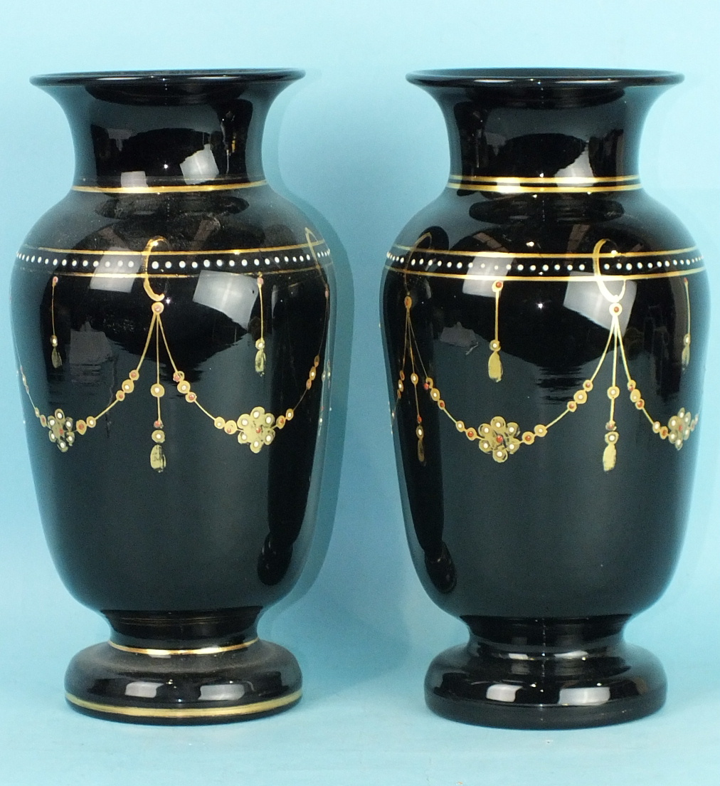 Lot 209 - Two Victorian amethyst glass vases decorated with gilt and enamel dots, 25cm high, (2).