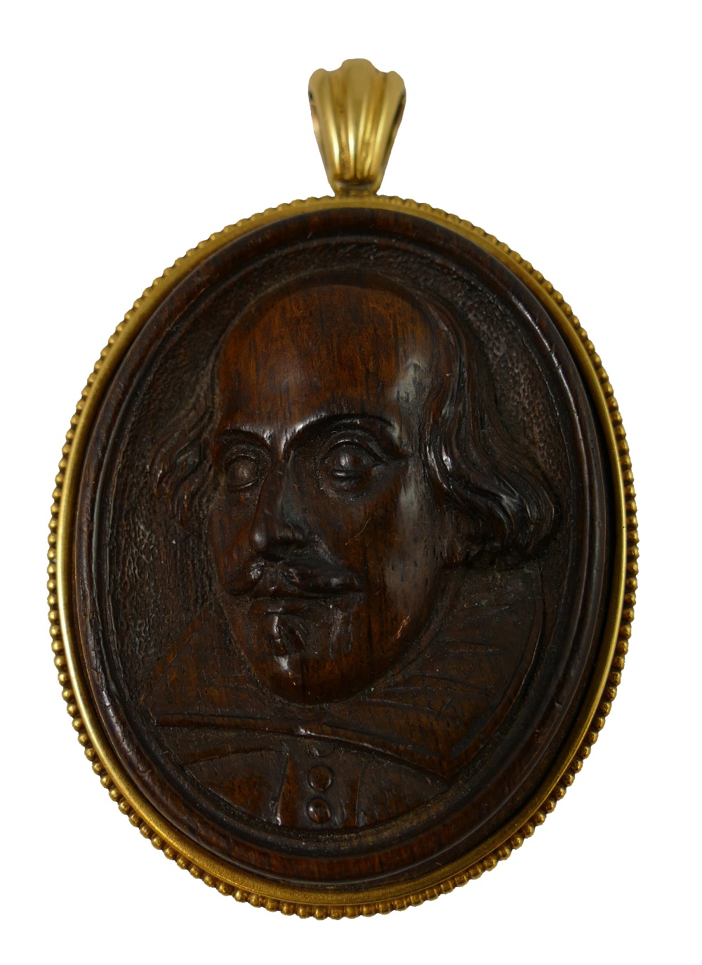 Lot 145 - Of Shakespeare interest - A Victorian 18ct gold and believed Mulberry wood carved pendant, circa