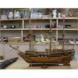 Lot 202 - A wooden model of a three masted ship length 81cm