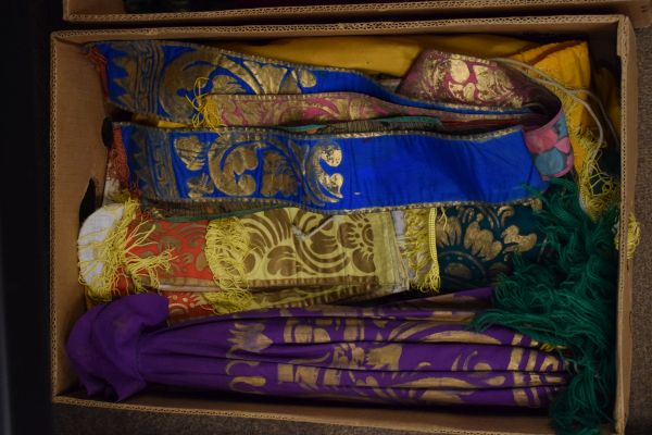 Lot 10 - Large selection of Oriental masks, textiles and other effects to include; ten painted carved