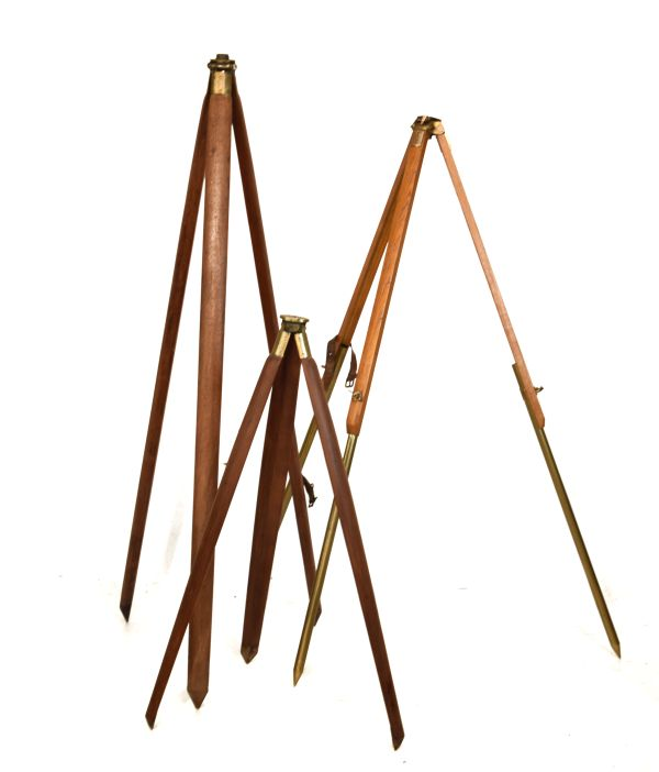 Lot 1 - Three early to mid 20th Century surveyor's brass-mounted wooden stands for a theodolite, level or