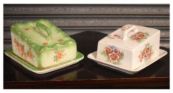 Lot 16 - Two early 20th Century transfer-printed pottery cheese or butter dishes Condition: