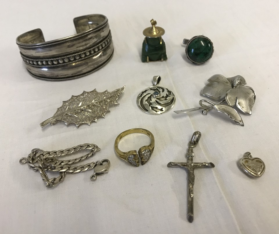 Lot 1011 - A small collection of silver and white metal jewellery together with a jade Buddha pendant.