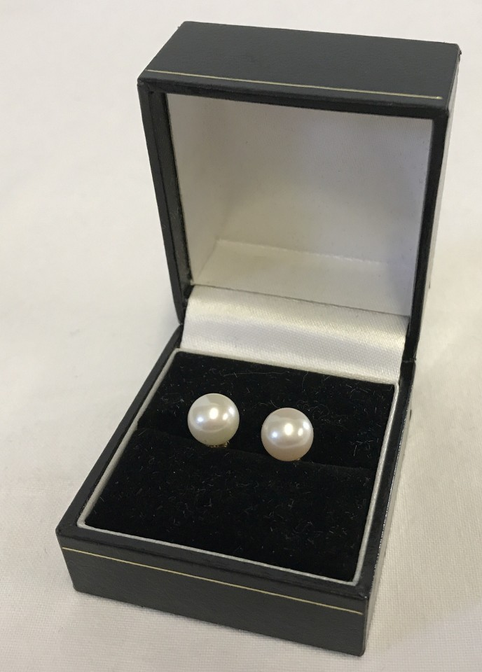 Lot 1019 - A pair of large real pearl earrings on 14ct posts.