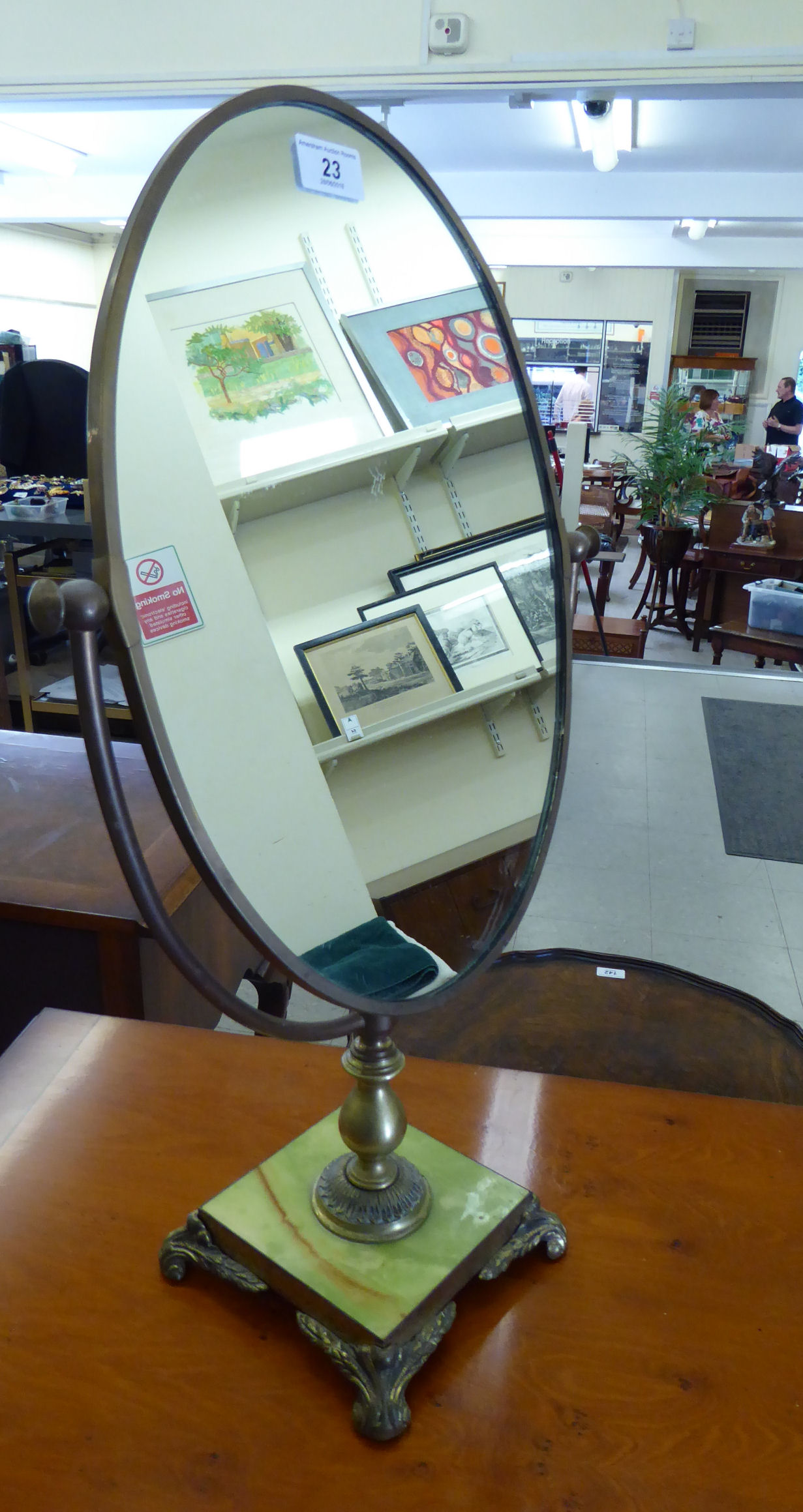 Lot 23 - A modern 'antique' inspired dressing table mirror, the oval plate set in a brass mount,