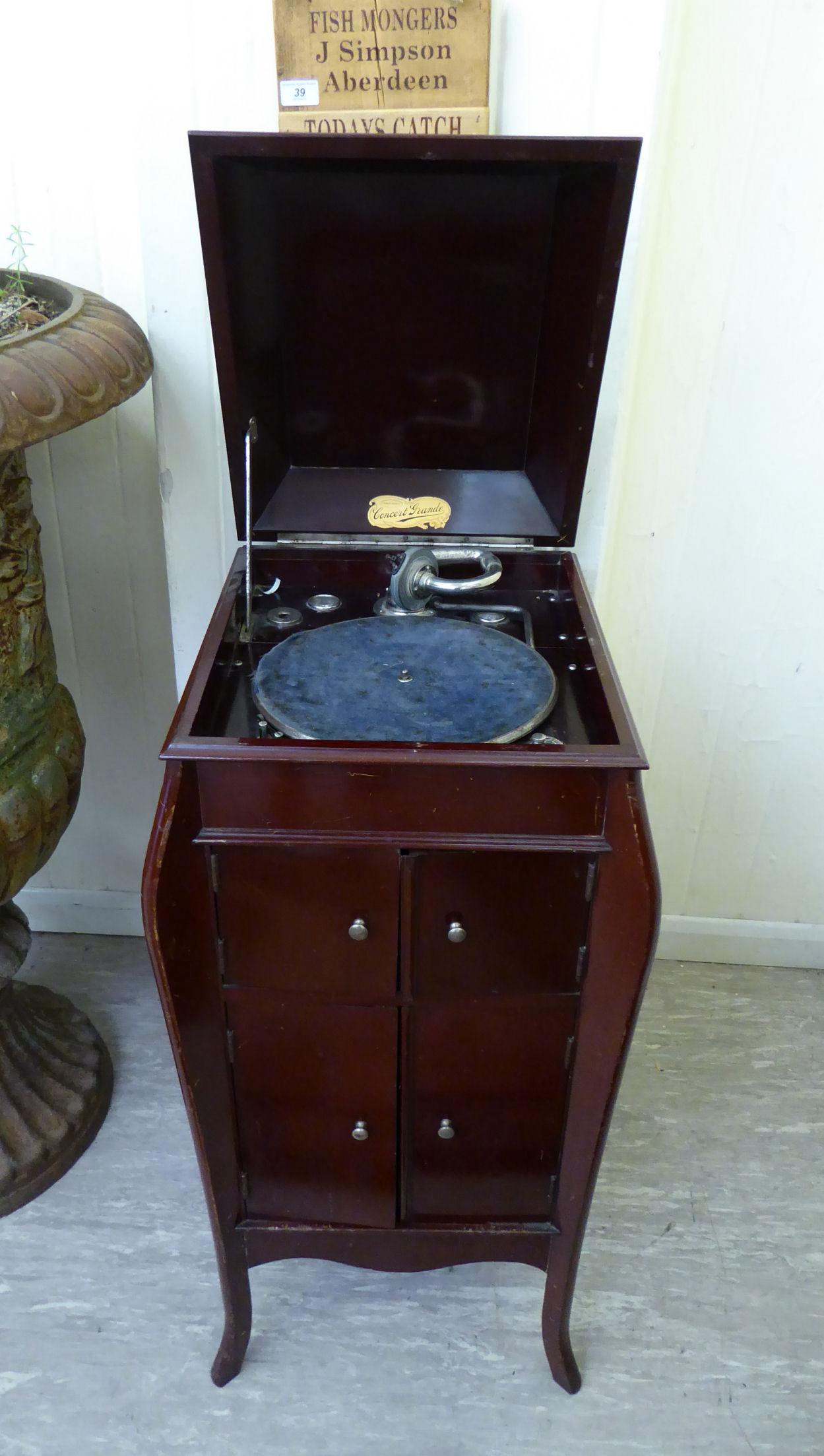 Lot 14 - A 1930s mahogany finished, freestanding Concert Grande gramophone cabinet, raised on slender,