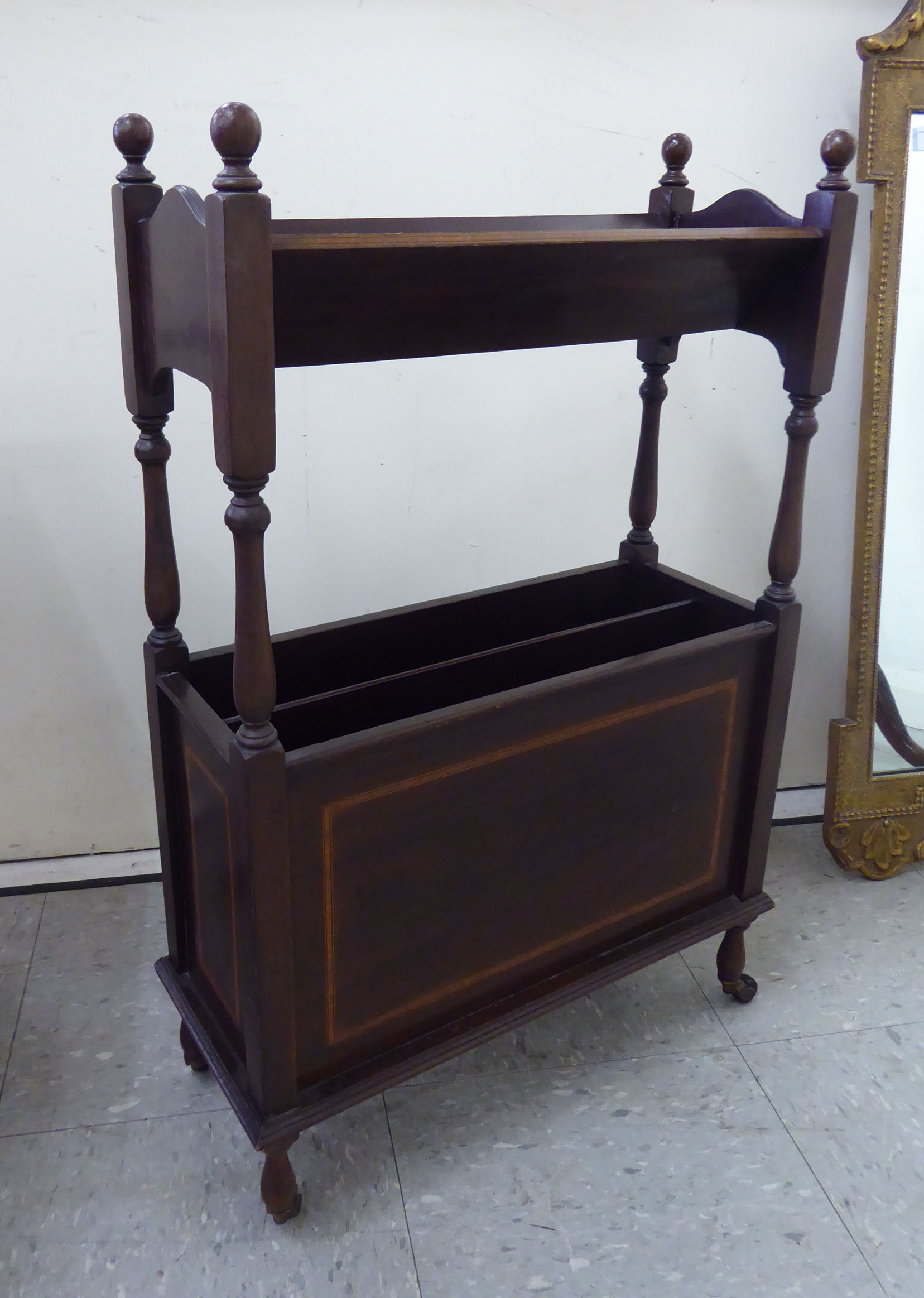 Lot 1 - An Edwardian crossbanded and string inlaid mahogany book trough, over a two division magazine rack,