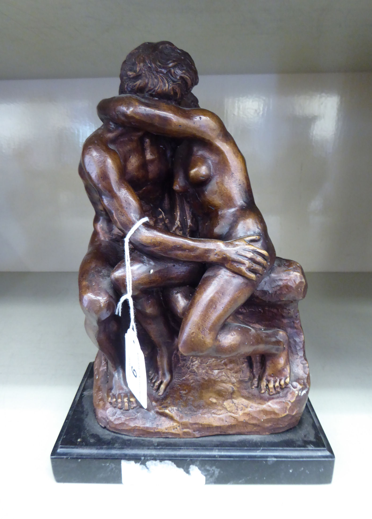 Lot 9 - A cast and patinated bronze group, an embracing couple,