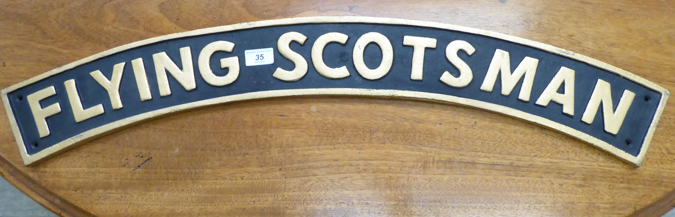Lot 35 - A cast and patinated cast iron sign 'Flying Scotsman' 32''w CA