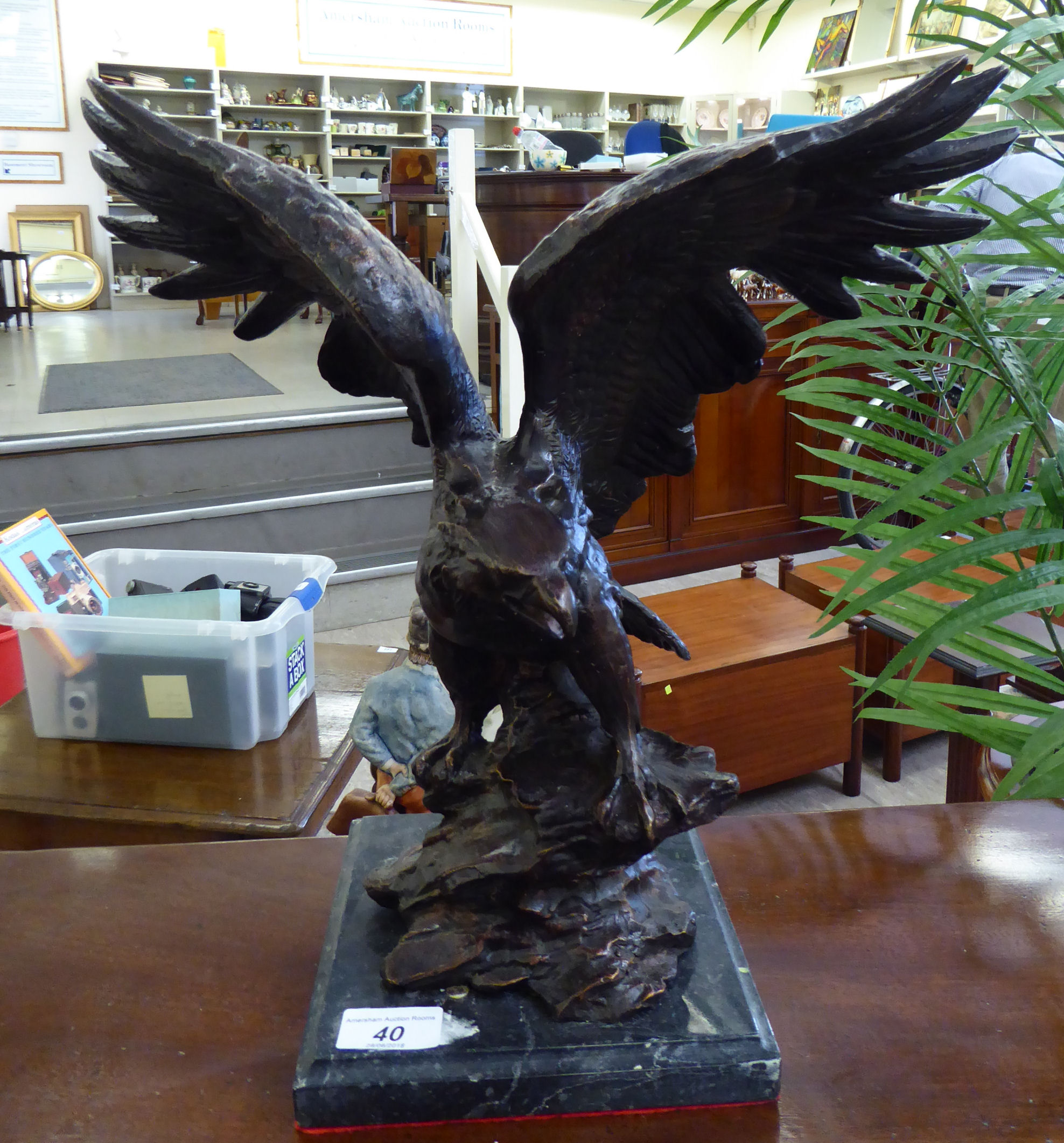 Lot 40 - A modern cast and patinated bronze model, an eagle,