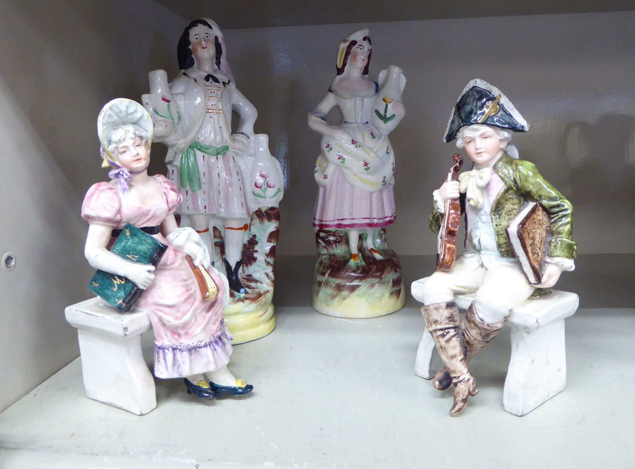 Lot 48 - A pair of late Victorian Staffordshire pottery figures,