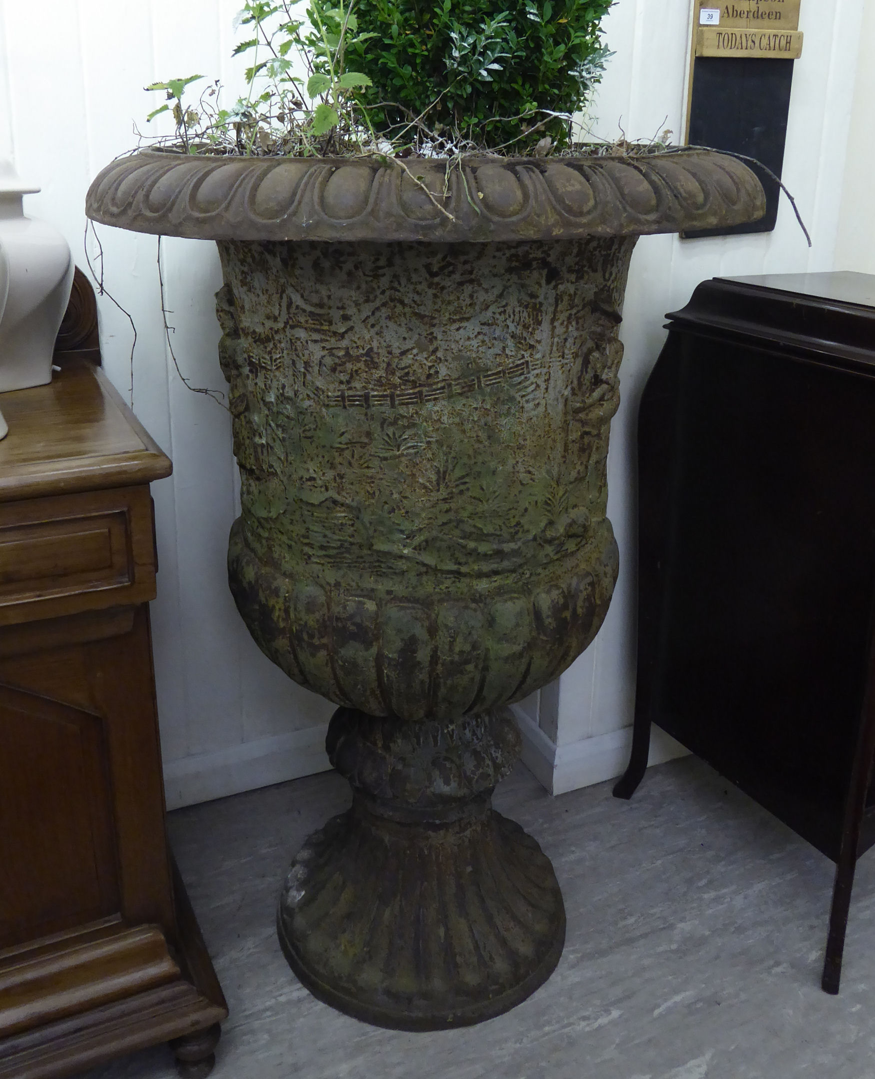 Lot 18 - A pair of 19thC style cast iron campana design terrace pedestal urns,