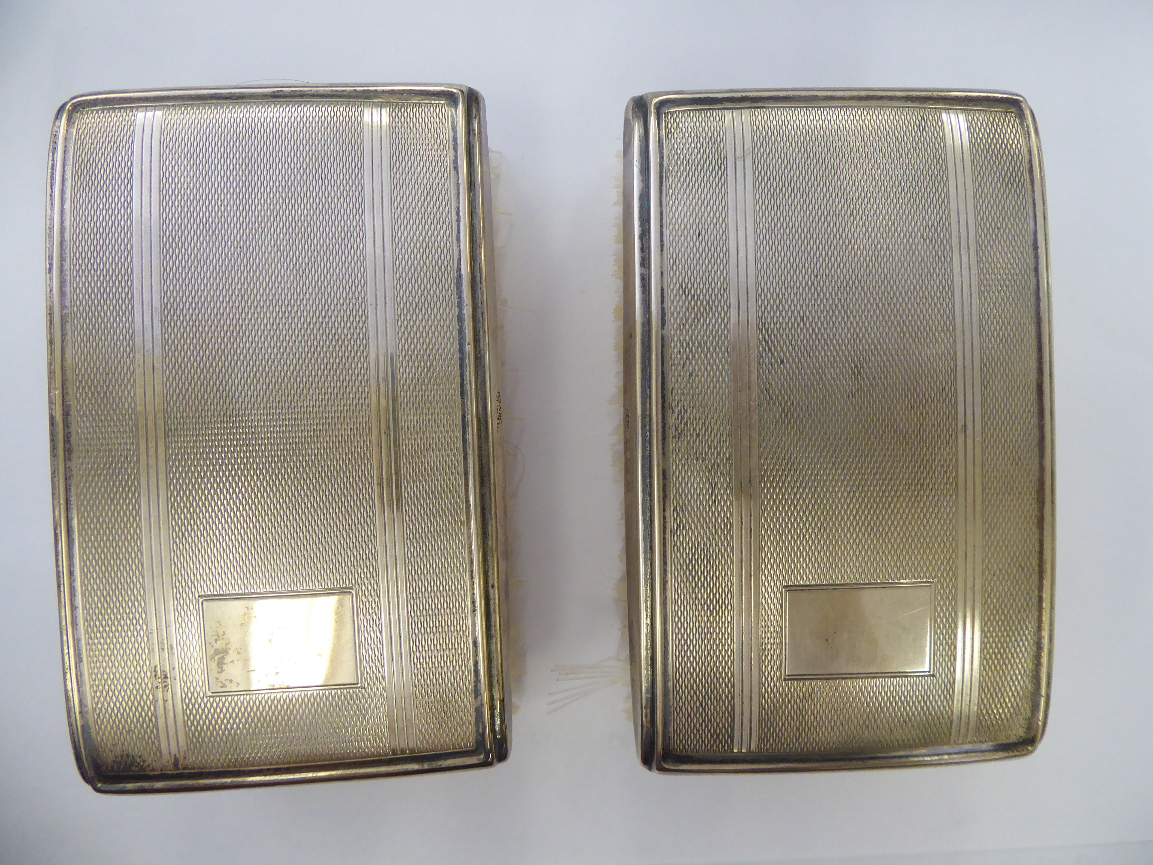 Lot 57 - A pair of silver backed clothes brushes with engine turned decoration Birmingham 1966 cased