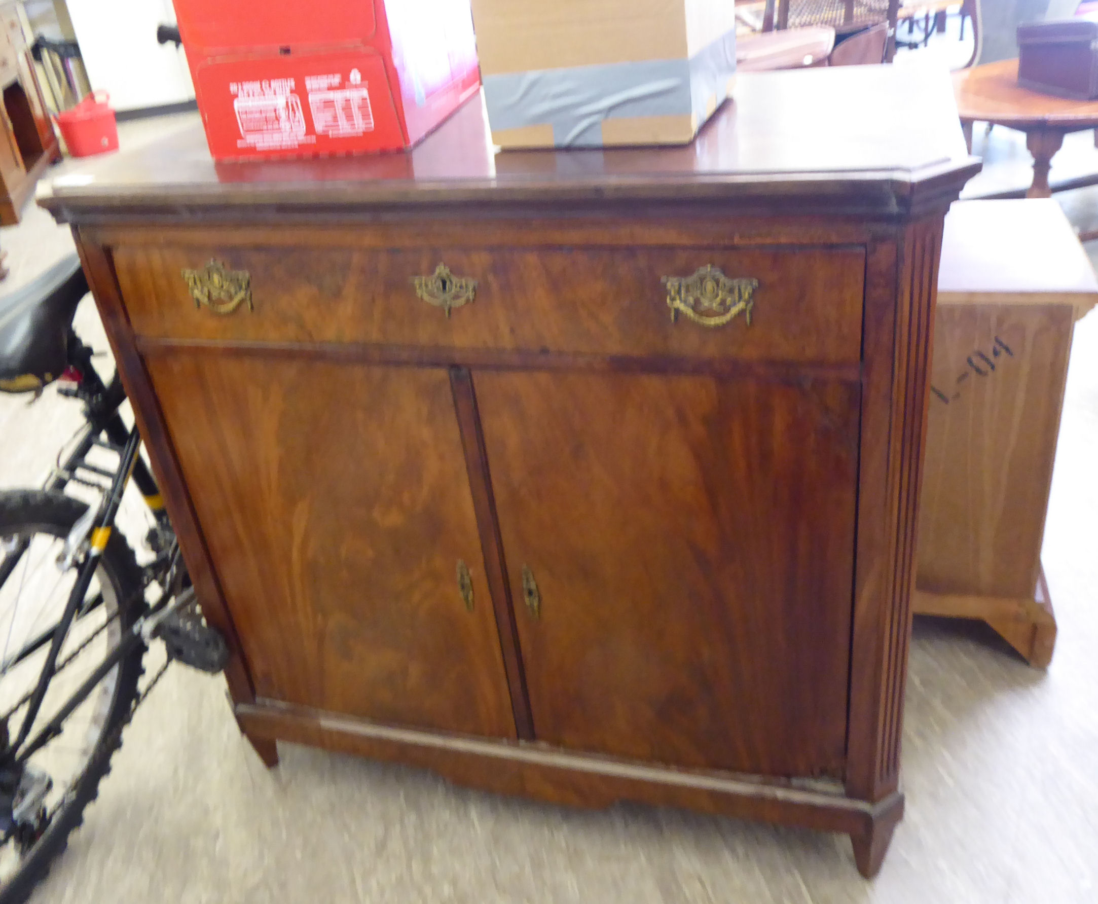Lot 38 - A mid 19thC Dutch flame veneered mahogany sideboard, the top with outset canted corners,