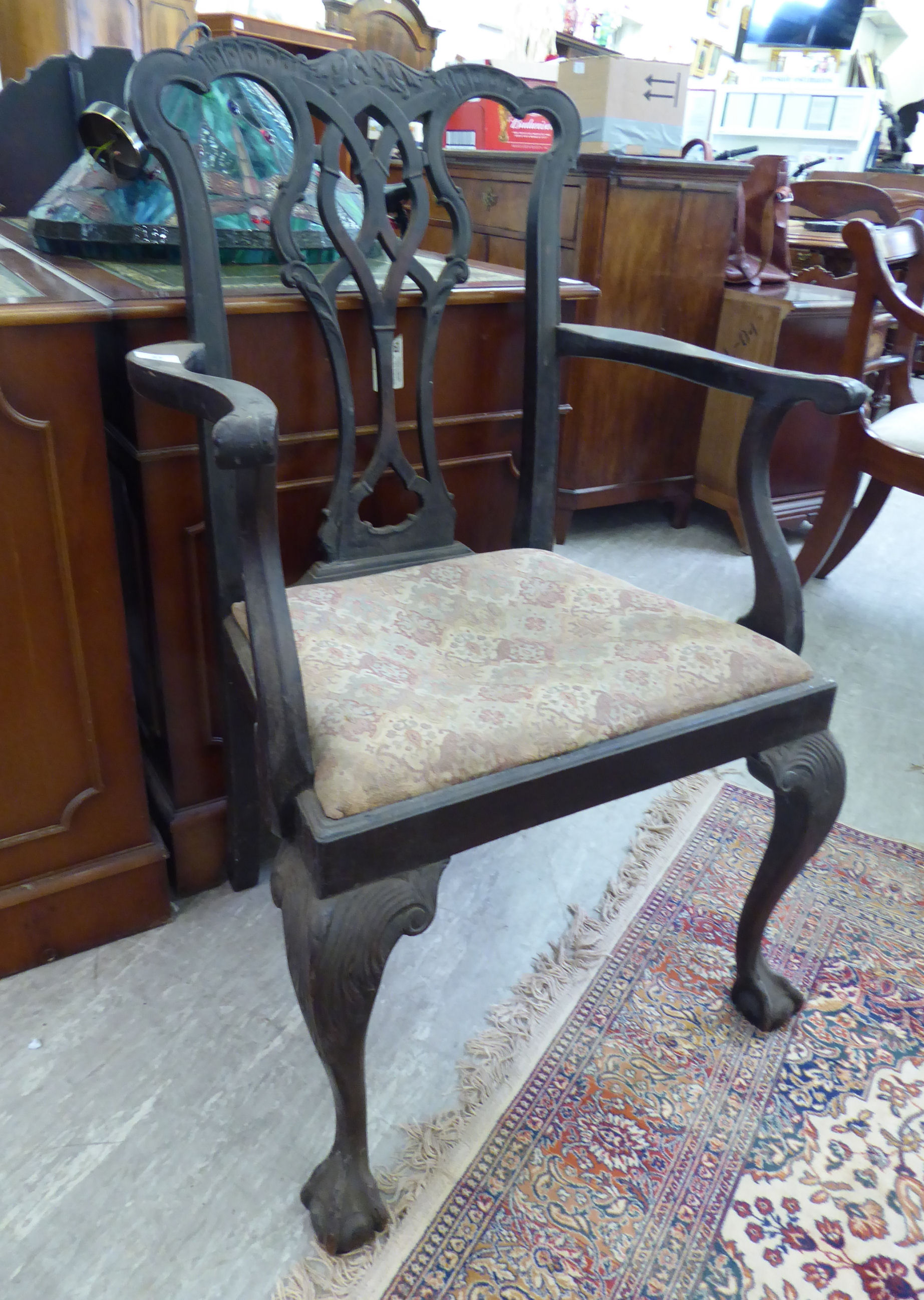 Lot 37 - A late 19thC Chippendale design mahogany framed elbow chair with a ribbon carved splat,