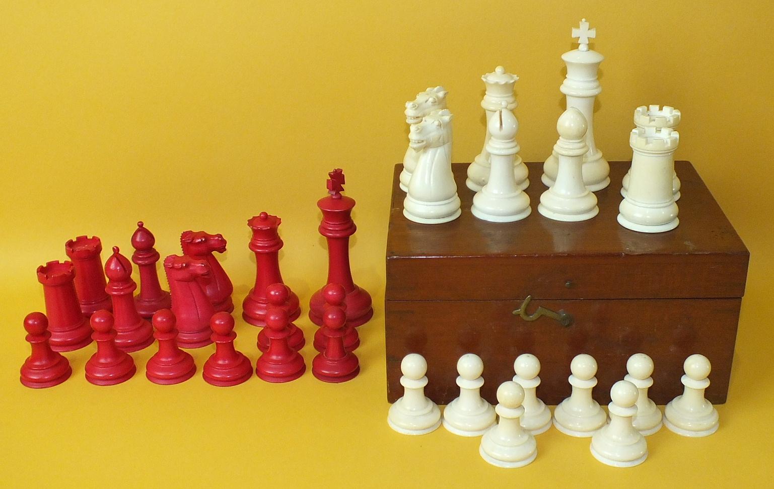 An Edwardian Staunton-style turned ivory chess set in rectangular walnut box, King 10cm.