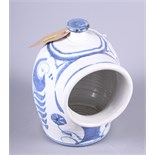 """An Aldermaston salt pig with blue floral decoration, 7"""" high"""
